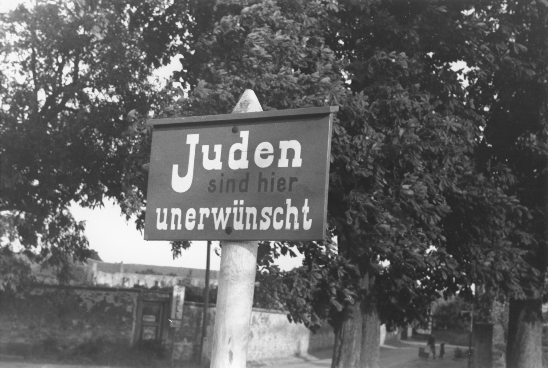 """An anti-Jewish sign posted on a street in Germany reads, """"Jews are not wanted here."""""""