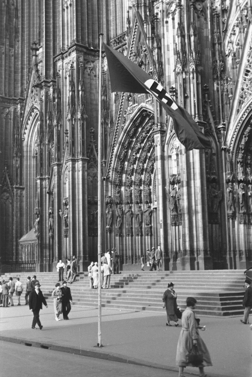 A Nazi flag flies in front of the Cologne Cathedral.