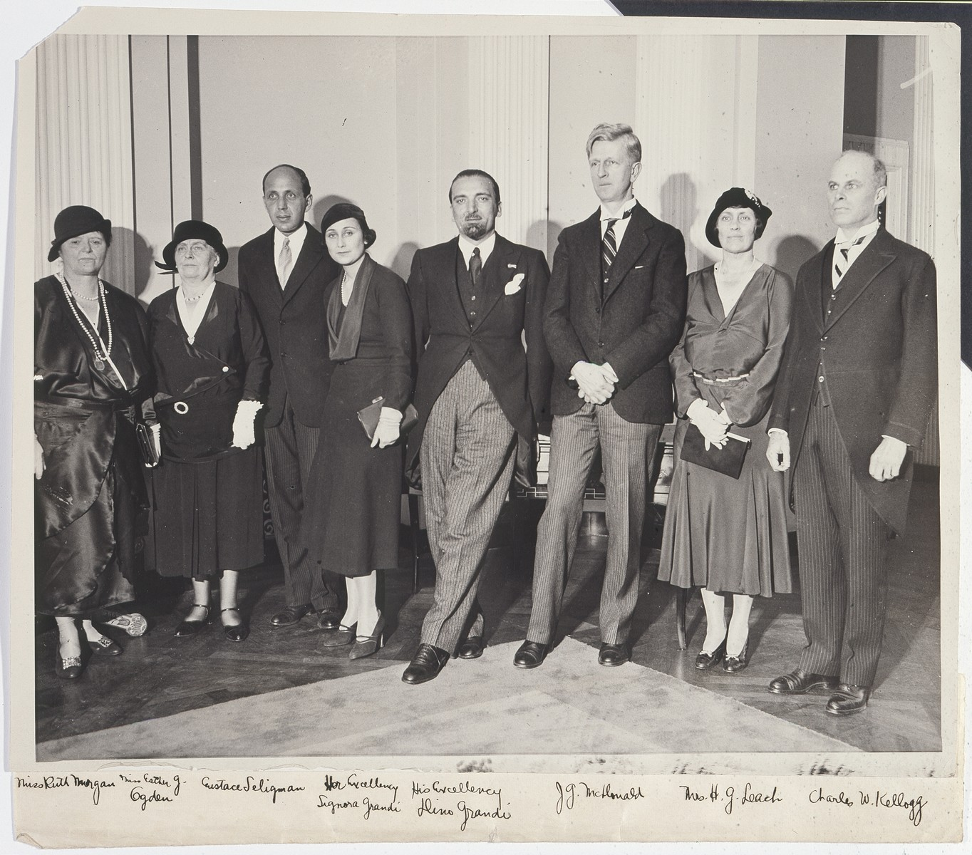 Group portrait of members of the board of the Foreign Policy Association of New York with Italian government official, Dino Grandi and his wife.  Pictured from left to right are: Ms. Ruth Morgan, Ms. Ester G. Ogden, Eustace Seligman, Signora Grandi, Dino Grandi, James G. McDonald, Ms. H.G. Leach and Charles Kellogg.