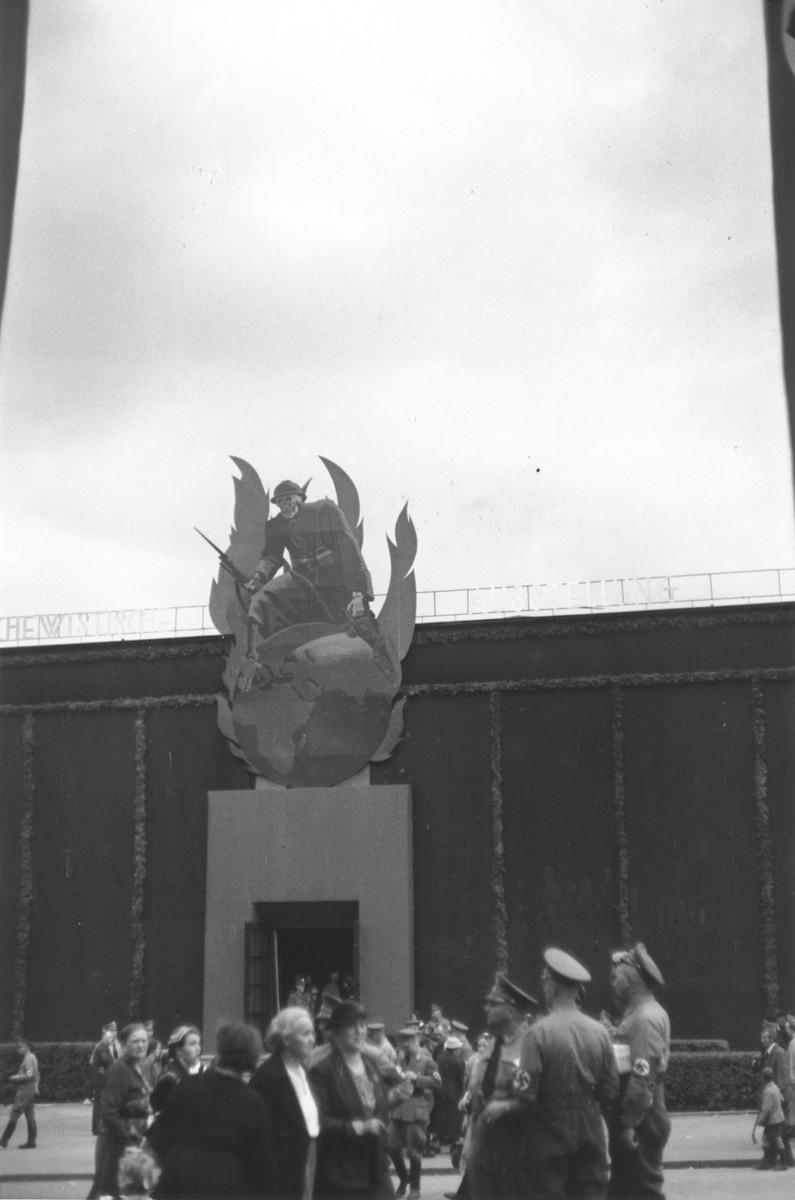 Visitors to the Great Anti-Bolshevism Exhibition 1937 (Grosse Antibolschewistische Ausstellung) in Nuremberg gather beneath a statue symbolizing the threat of Bolshevism in the world.
