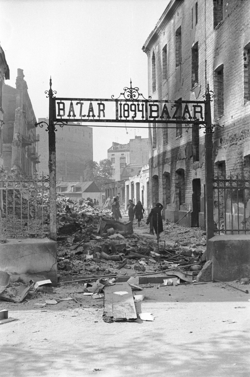 View of the entrance to a market that has been reduced to rubble as a result of a German aerial attack.