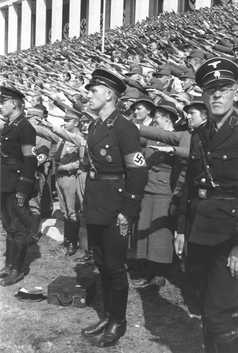 German SS troops stand in front of the crowd of saluting spectators at the 1937 Reichsparteitag (Reich Party Day) celebrations in Nuremberg.