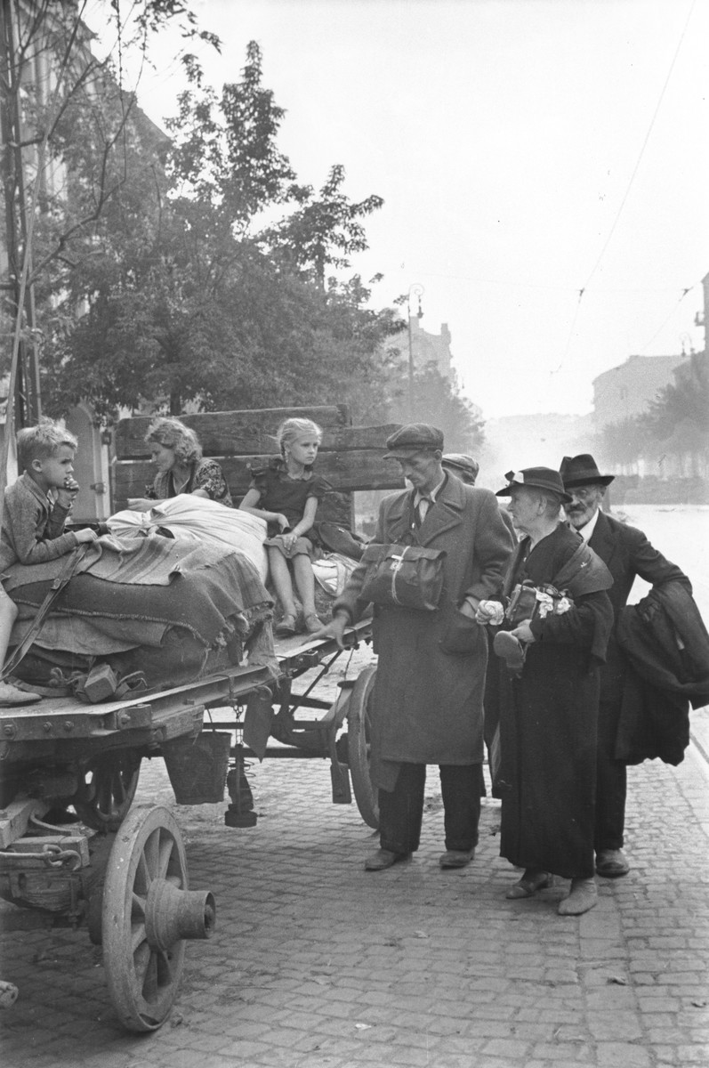 A family of Polish peasant refugees arrive in Warsaw on a horse-drawn wagon during the siege of the capital.