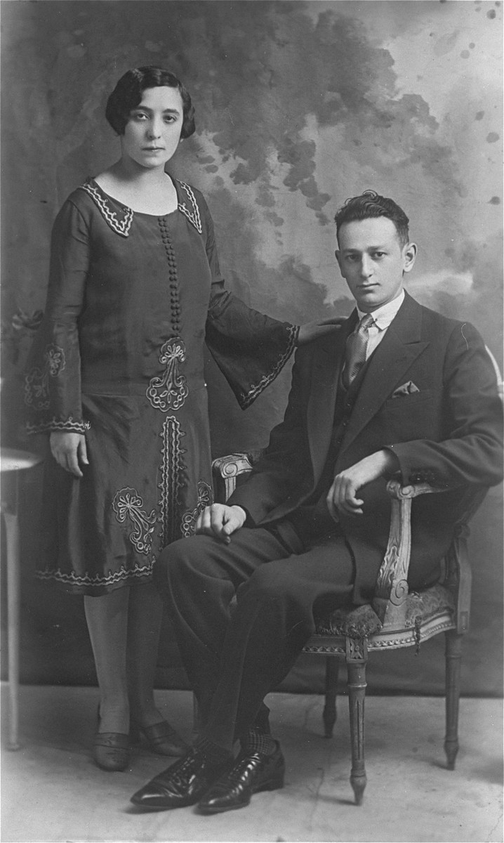 Studio portrait of a Polish Jewish couple, members of the Szczupacki family.