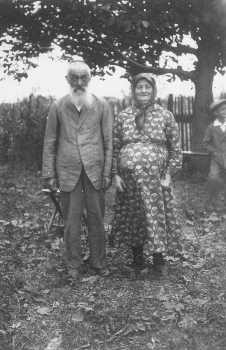 Portrait of Chana Leah and Joseph Petranker, the grandparents of Amalie Petranker, in the yard of their home.