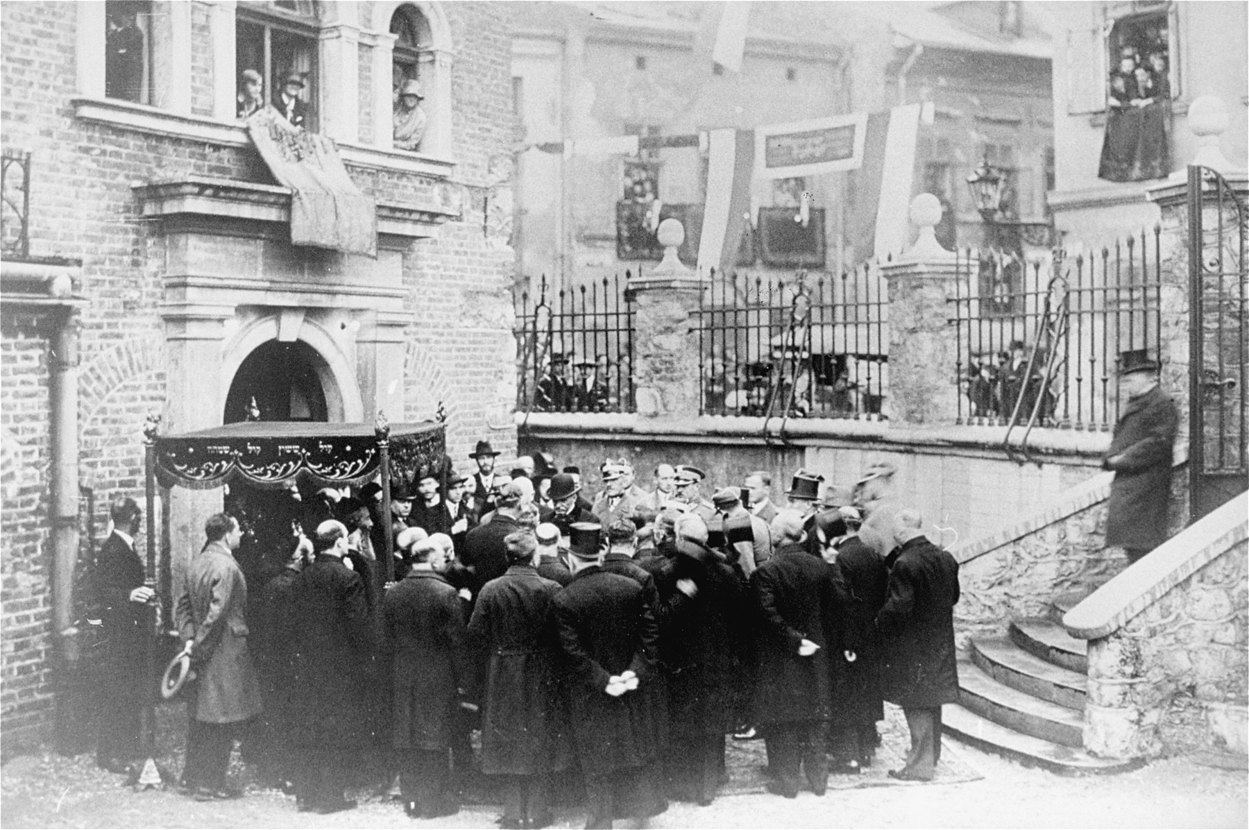 Leaders of the Jewish community greet General Jozef Pilsudski in the courtyard of a synagogue in Krakow.