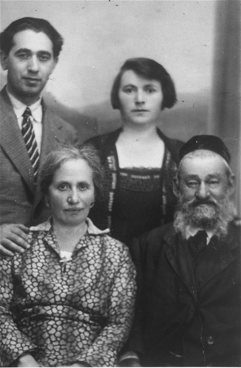 Portrait of the Gaenger family.  Pictured standing are Max Gaenger;  Frieda (Gaenger) Petranker.  Seated in the front row are Rivka and Yehuda Leib Gaenger, the grandparents of Amalie Petranker.