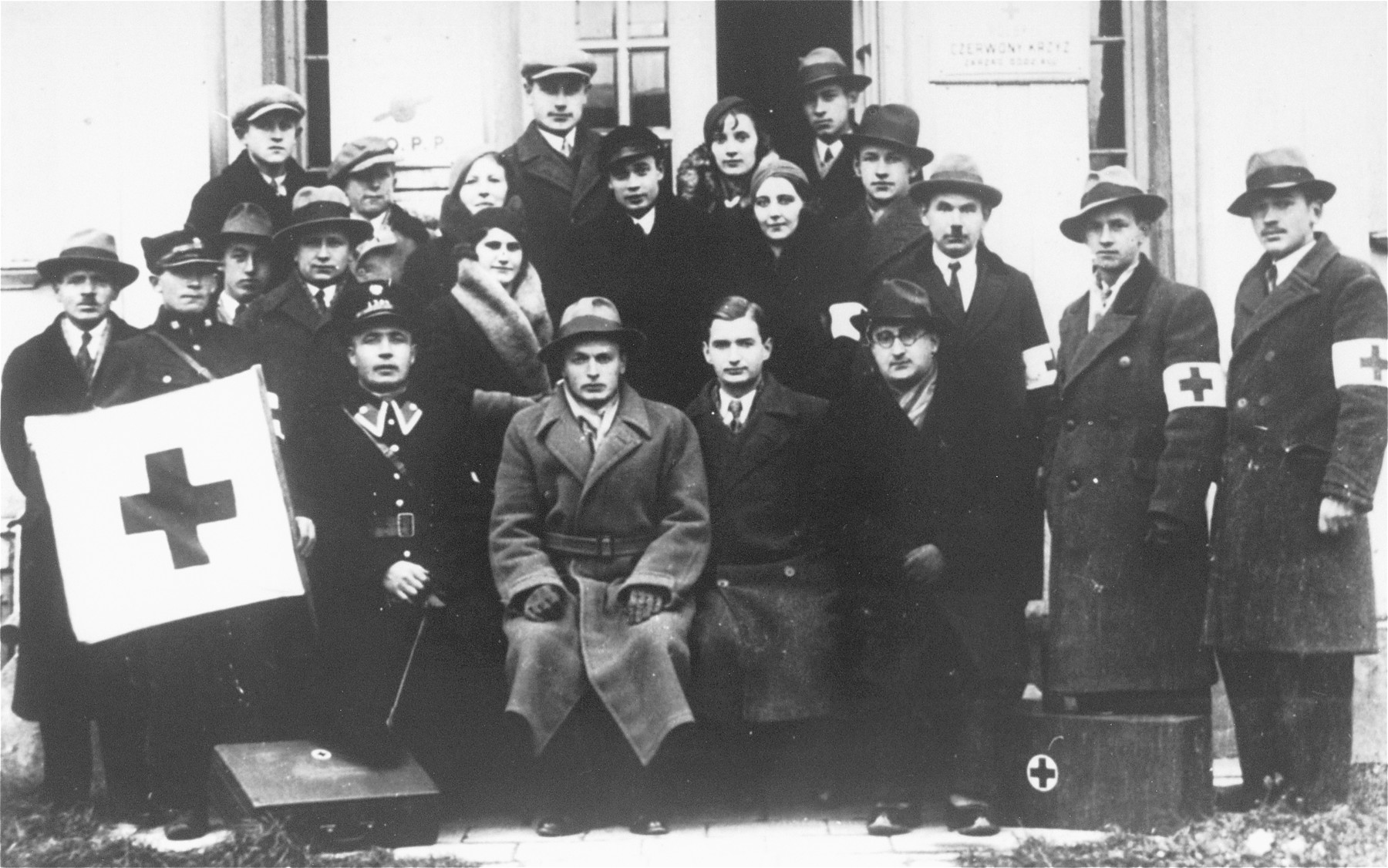 Group portrait of members of the Polish Red Cross, among them one Jew, Dr. Marek Marienstrauss, sitting on the far right.
