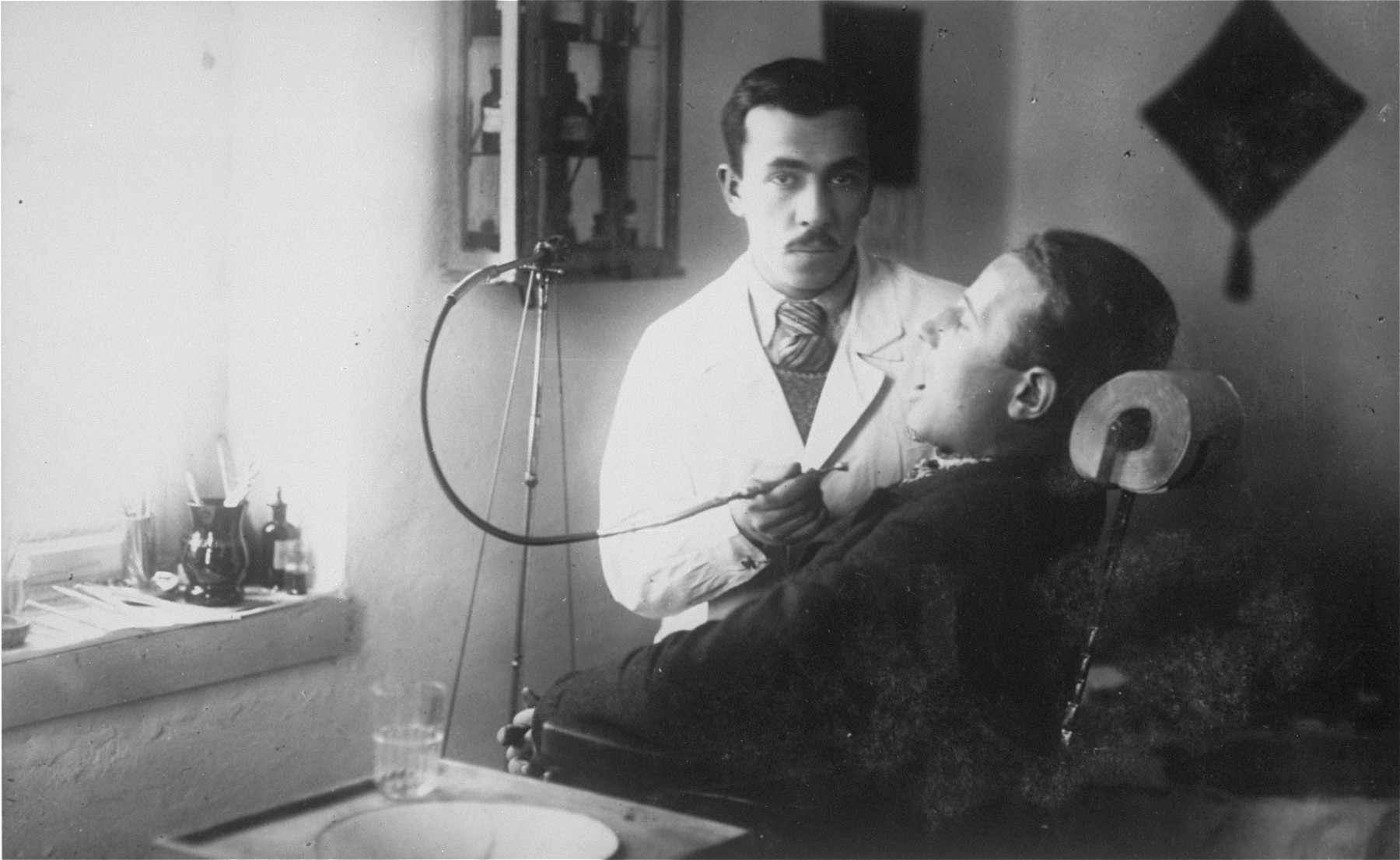 Boris Goldberg treats a patient in his dental office.