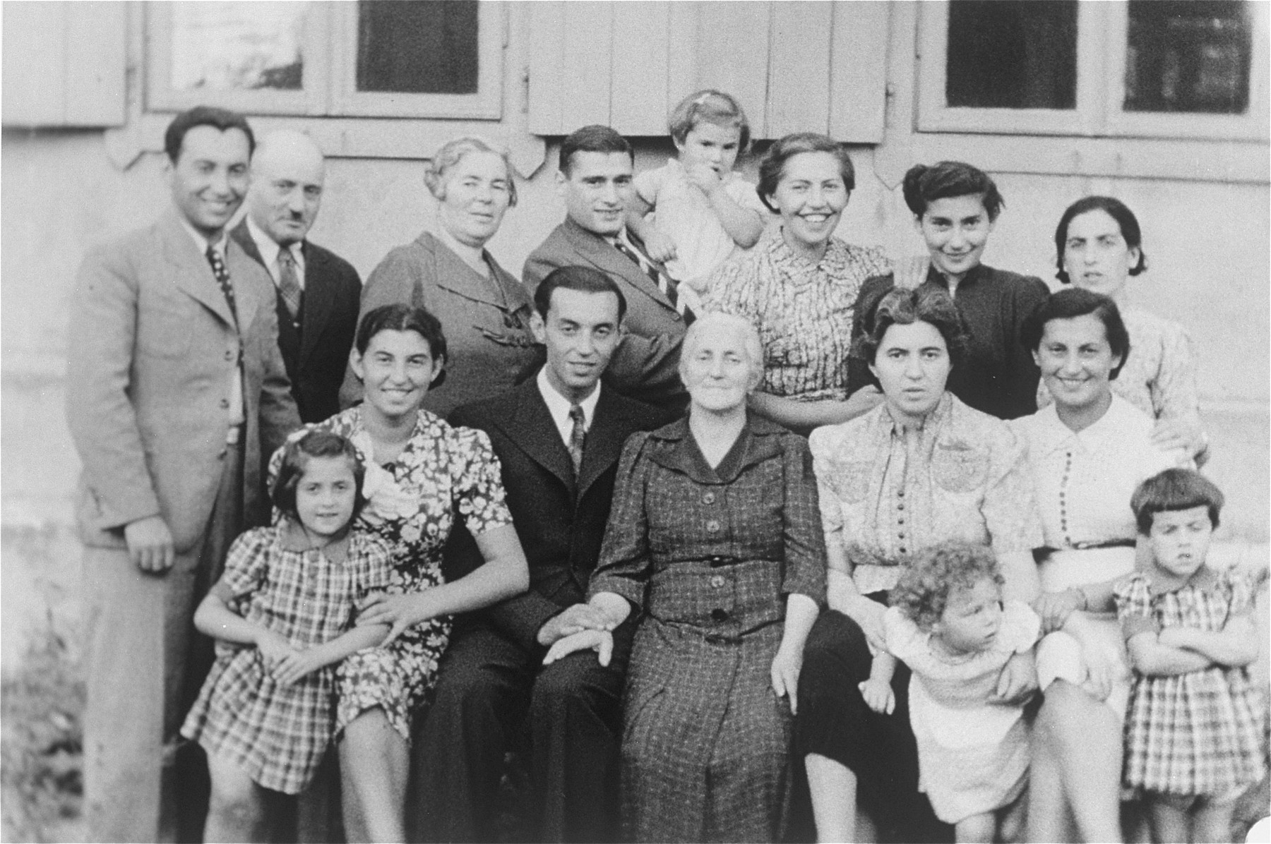 Portrait of the extended Katz family in Vilna.    The photo was taken during their daughter Mina's visit from Montreal.  Among those pictured are Mina (Katz) Herman and her daughter, Audrey (front row, second from the right), Itzik Katz, Mina's brother (standing at the far left) and Malka Katz, Mina's mother (front row, center).
