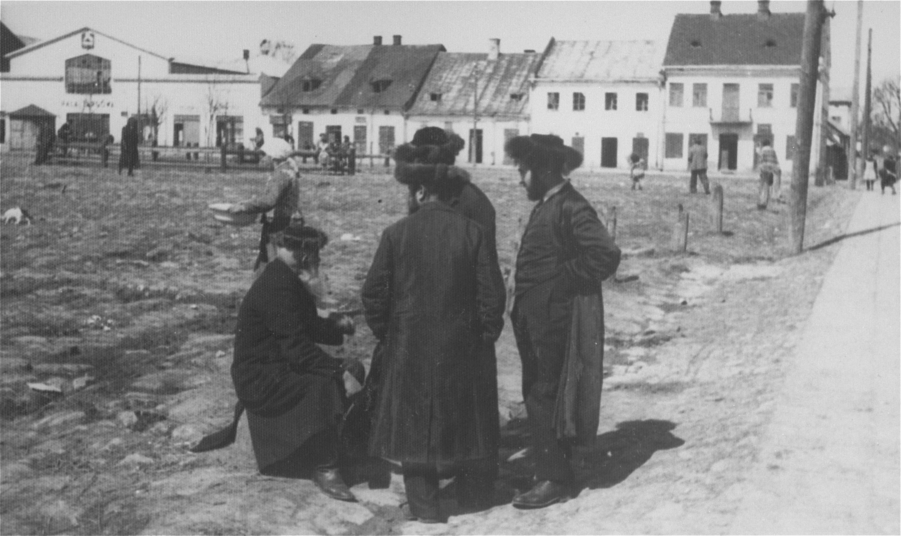 A group of Hasidic Jews in the market square of a small town near Stanislawow.