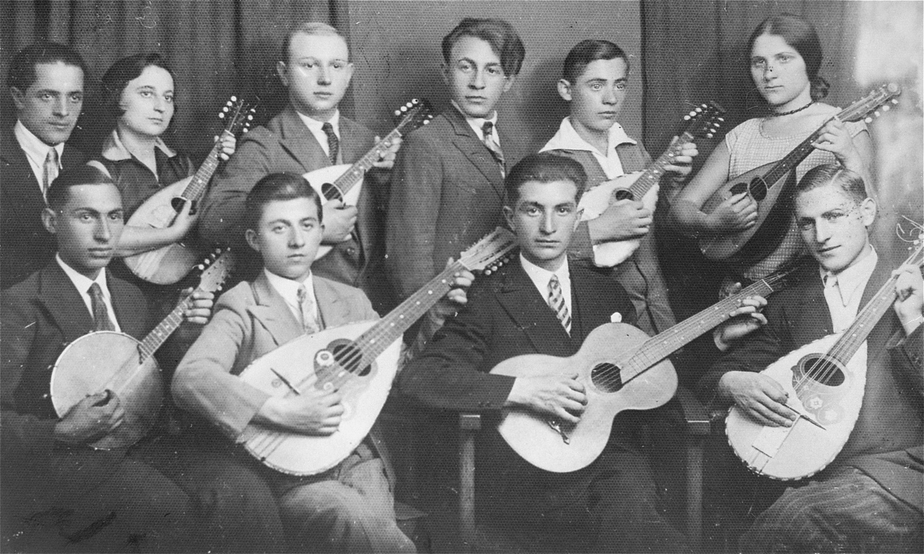 Group portrait of the members of a Jewish youth orchestra.  In the second row: second from left is Fela Kamionkowska Kiwajko and first from right is Hana Kamionkowska Bromberg.  Both were cousins of donor's late husband, Joseph Steinberg.
