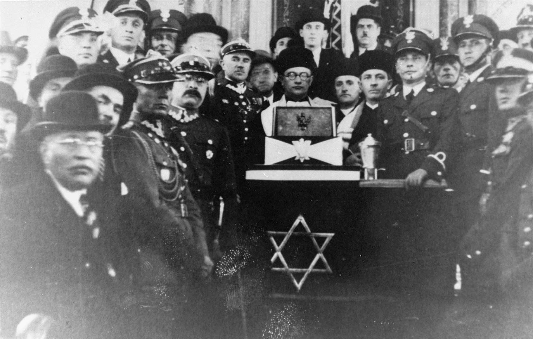 Chief Rabbi of the Polish Army, Boruch Steinberg poses with a group of Polish officers in a Krakow synagogue.  Rabbi Steinberg was later killed in Katyn massacre.