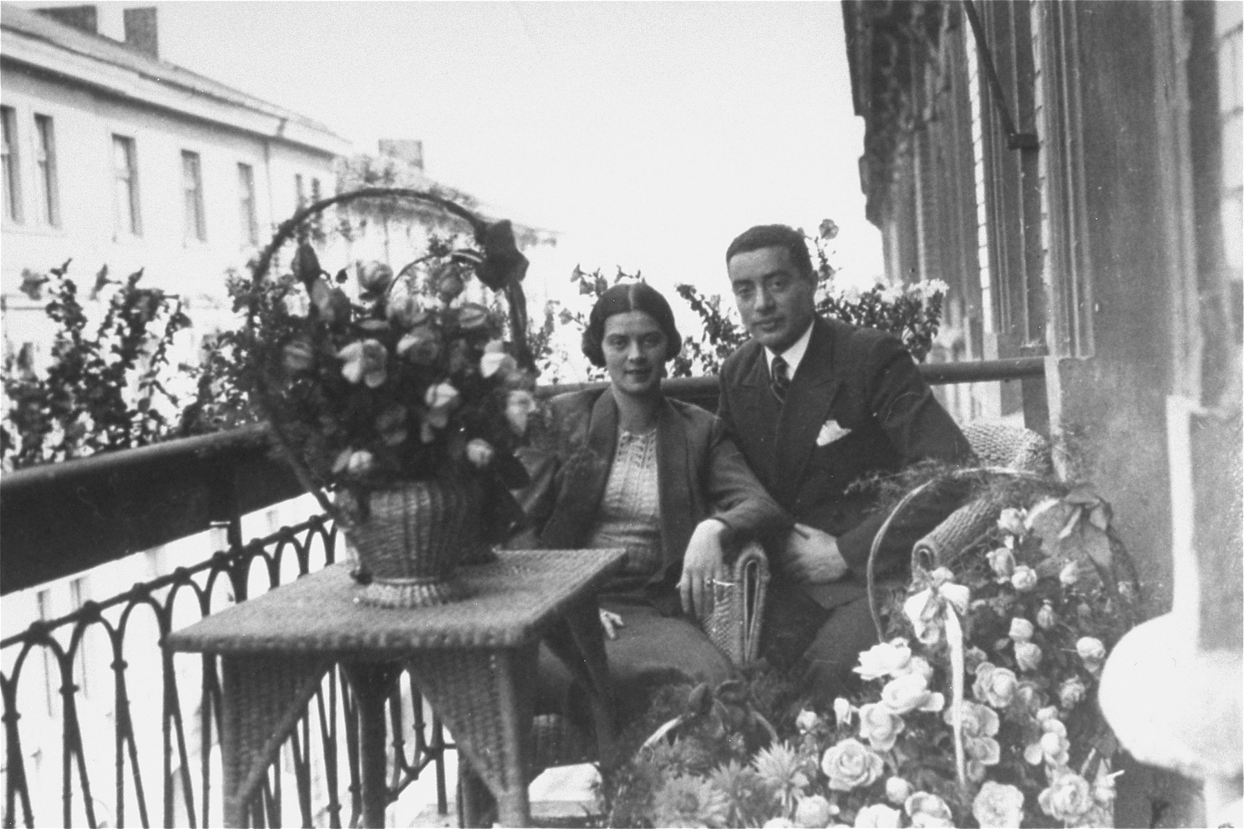 Portrait of a Jewish couple on a balcony in Rzeszow, Poland during their engagement party.   Pictured are Mina Nattel and Beno Schmelkis. During the war Mina, Beno and their daughter Rachel were killed by the Germans.