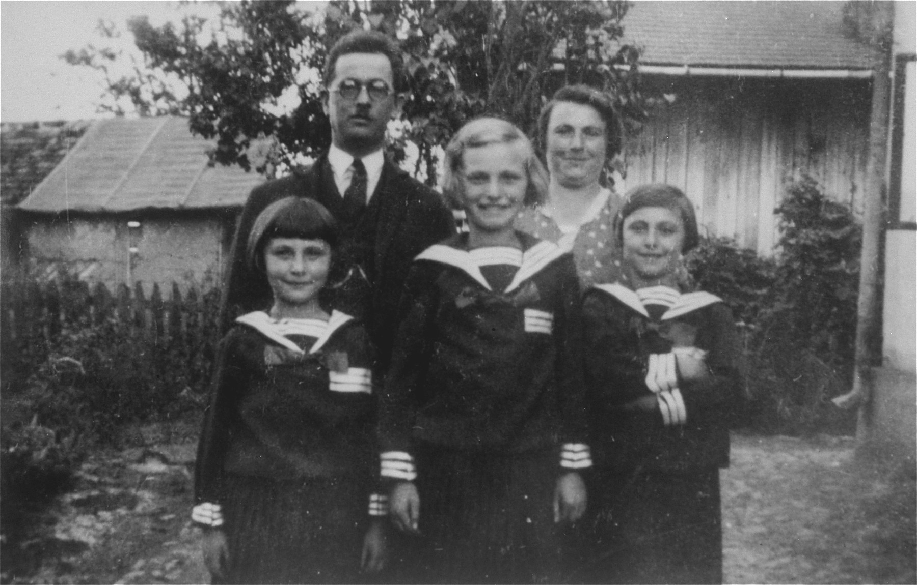 Portrait of the Petranker family while living in the Niemiecka Kolonia (German Colony).  Pictured in the back row, from left to right, are; David and Frieda Petranker.  In the front row, from left to right, are: Celia, Pepka and Amalie Petranker.