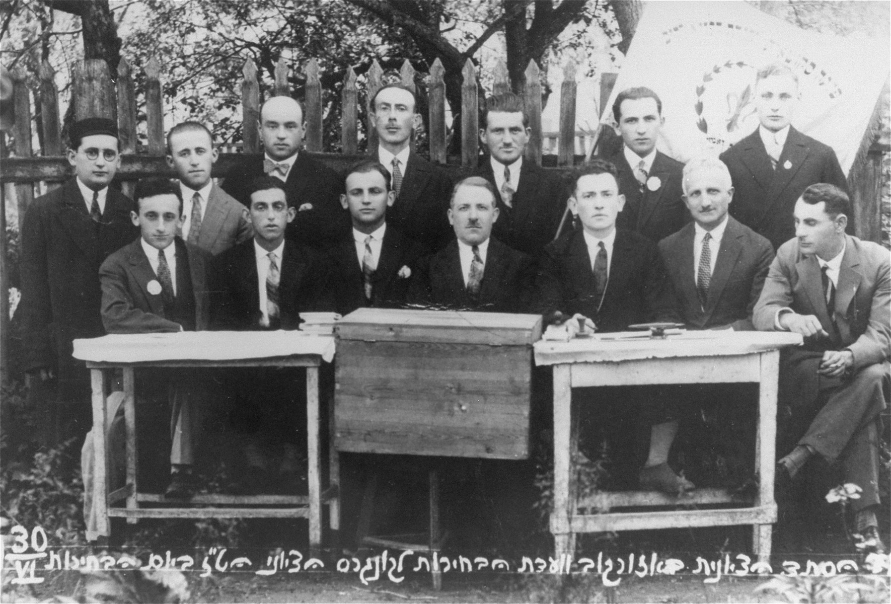 Group portrait of members of the Ozorkow election committee for the 16th Zionist Congress.   Among those pictured are: Mayer Zabner, the donor's uncle (front row, second from the right), Mr. Feldman (front row, right), Mr. Winter (front row, center), Mr. Rosenblum (front row, left).