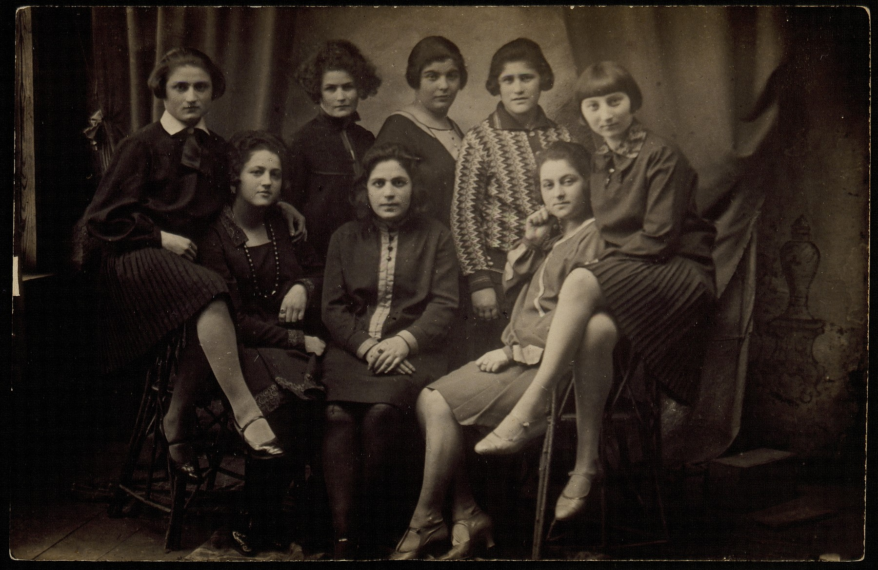 """Group portrait of young Jewish women who were members of the """"Club 21"""" in Eisiskes.  Among those pictured are Zipporah Katz (seated on the right), Kumin (second from the right), Etele Yuranski (fourth from the right), Geneshe Kaganowicz (far left) and Matle Sonenson (second from the left).  Zipporah, Geneshe and Matle later became sisters-in-law.  Matle survived the war in Siberia; Etele was killed in the Radun ghetto on May 10, 1942; Kumin died in Auschwitz; Zipporah was killed by members of the Polish Home Army in October 1944.  The others were killed by the Germans during the September 1941 mass shooting action in Eisiskes."""