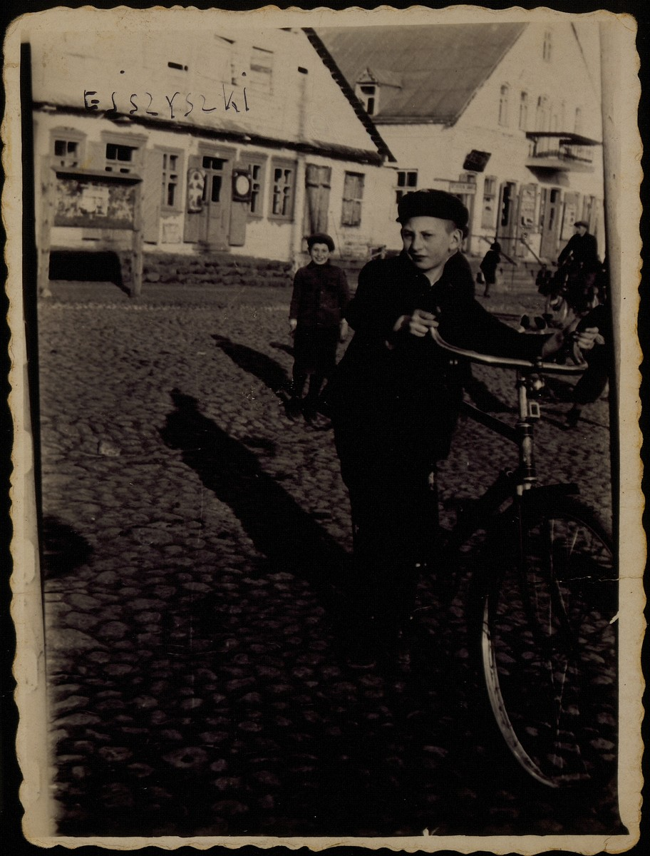 Avigdor Katz poses in Market Square with his new bicycle which he received as a birthday present.  Avigdor was killed by the Germans during the September 1941 mass shooting action in Eisiskes.