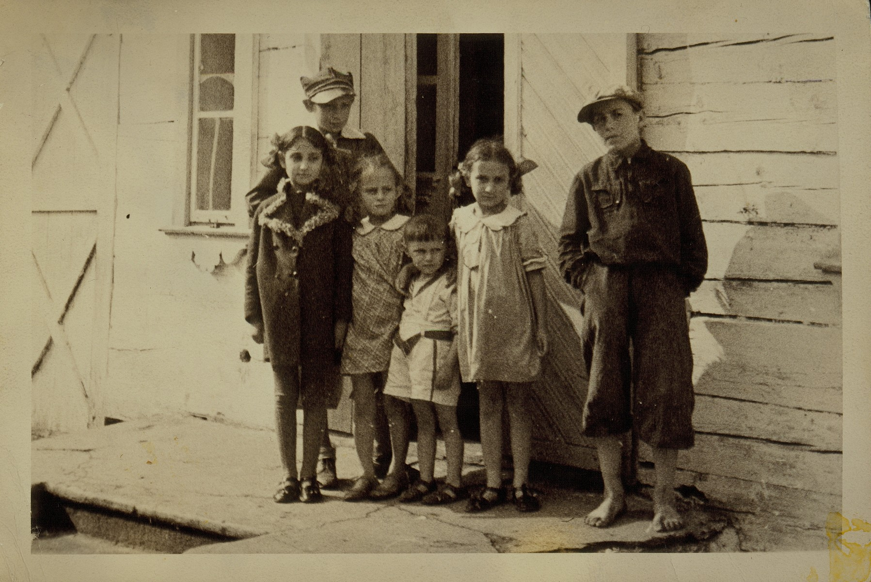 Group portrait of children in front of a private home in the town of Eisiskes.  The Jews of this shtetl  were murdered by the Einsatzgruppen on September 21, 1941.