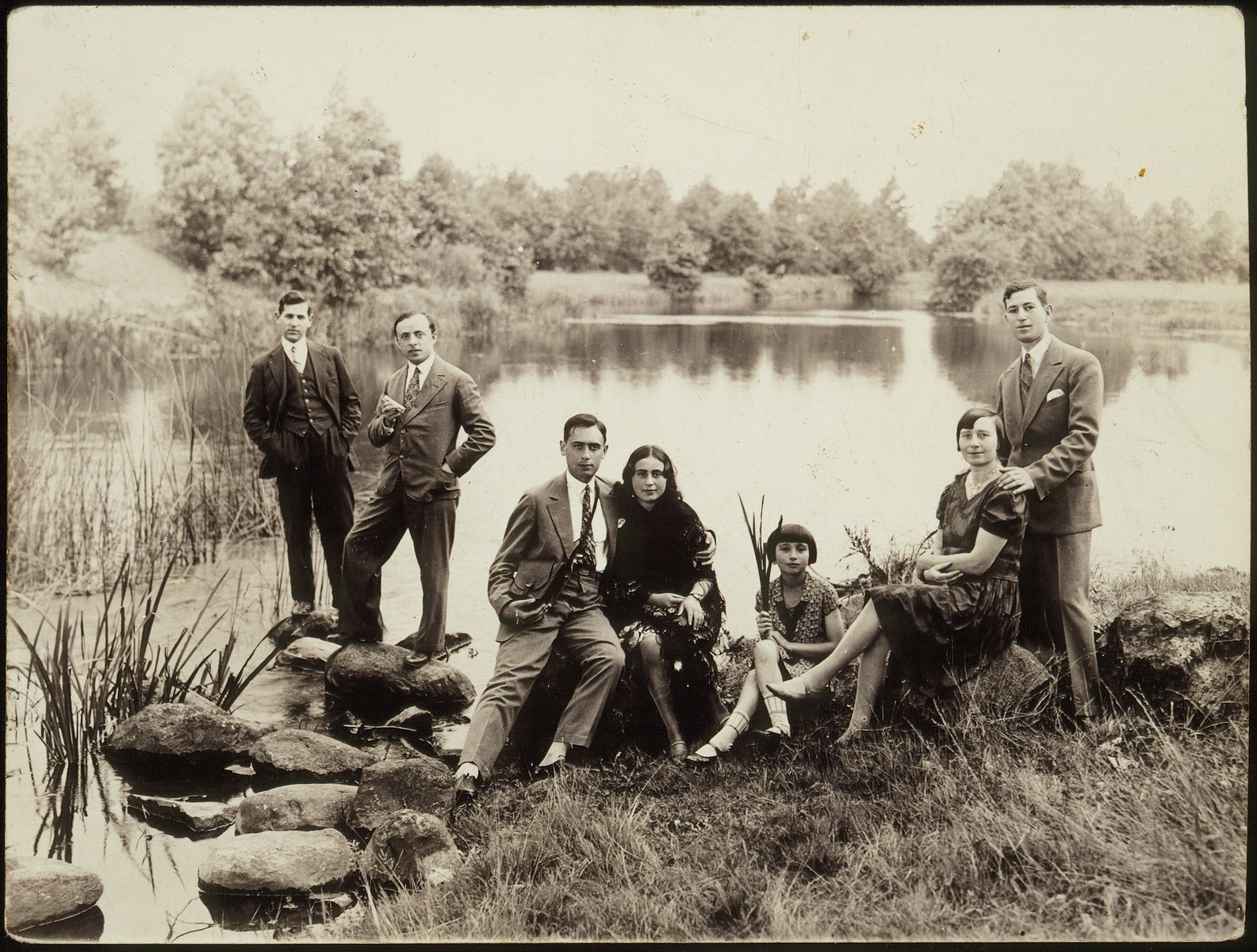 Members of the Kudlanski and Dubrowicz families pose on the shore of a lake near Eisiskes.  Among those pictured are Hanneh-Beile (Moszczenik) Kudlanski (second from the right), her daughter Atara Kudlanski, Leah Dubrowicz and her brother Shaul Dubrowicz.  The Kudlanski family immigrated to America; the Dubrowiczes perished during the Holocaust.