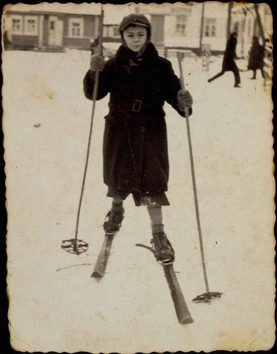 A Jewish child poses on skis in the market square in Eisiskes.  Pictured is Benyamin Sonenson.  He was killed with his mother and brother by the Germans in the September 1941 mass shooting action in Eisiskes.