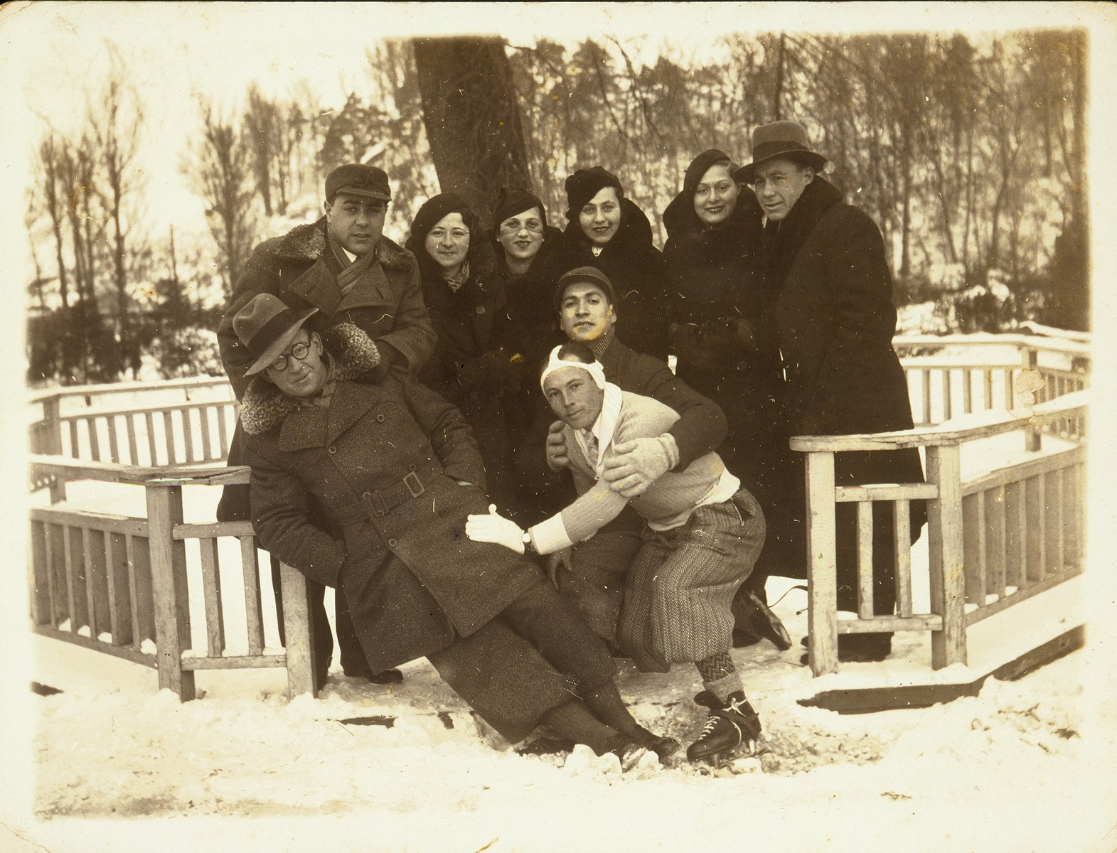 A group of young Jewish men and women from Eisiskes and Vilna pose outside in the snow.  Among those pictured are Feigele Blacher (standing in the back, second from the right) and Sara Haske Lubetski Dugaczanski.