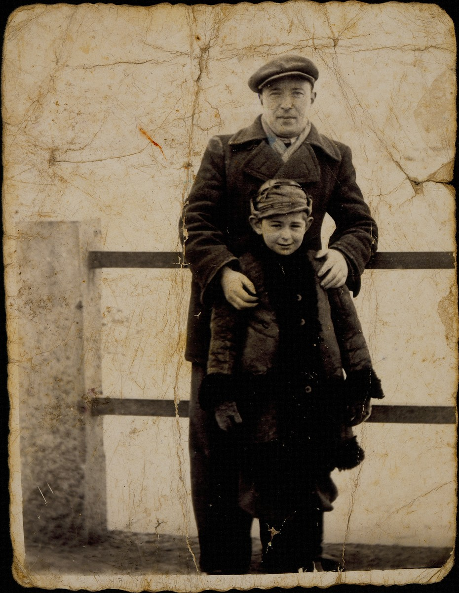 The photographer, Ben-Zion Szrejder, who managed the photography studio of Alte Katz, poses with her oldest grandson, Yitzhak Sonenson, on the shtetl bridge.