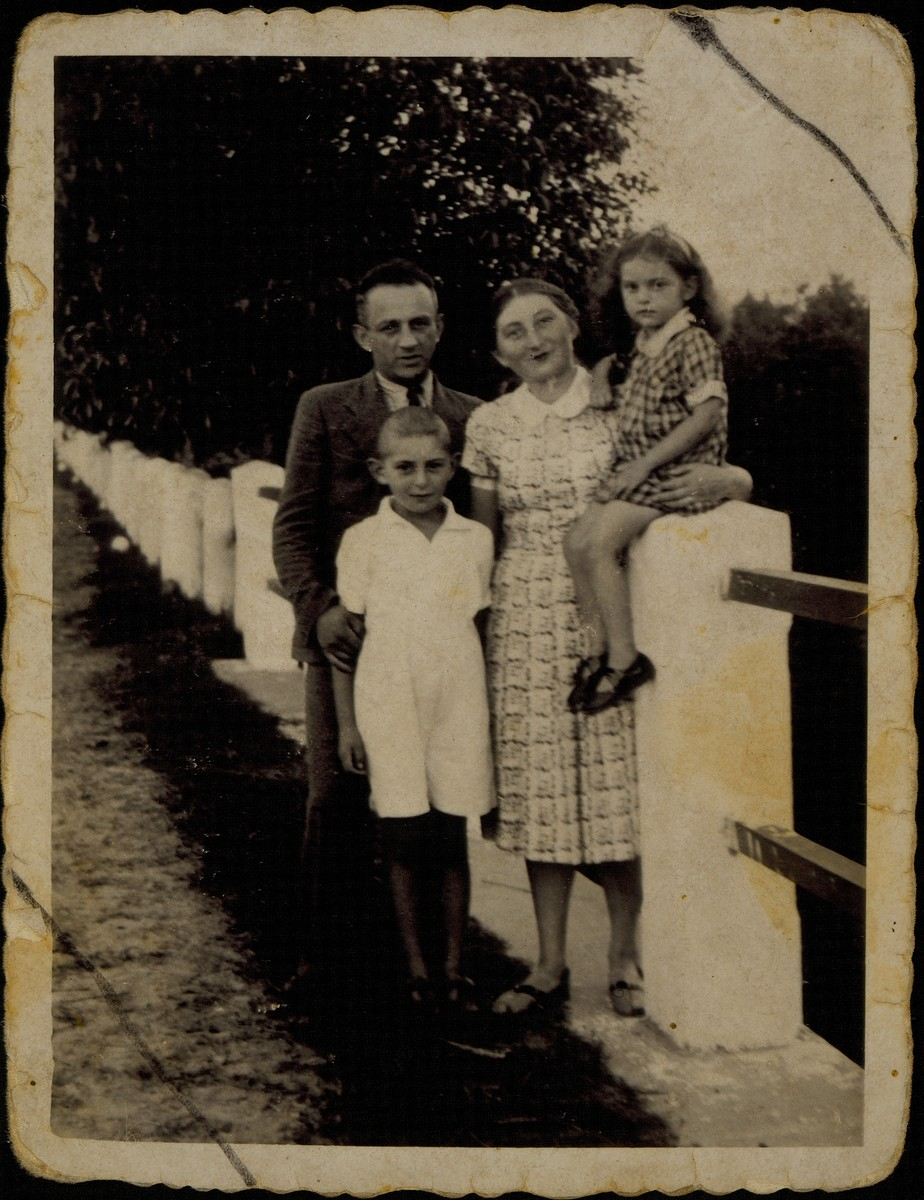 Moshe and Zipporah Sonenson pose with their children, Yitzhak and Yaffa, on a bridge in the Tetlance Forest.