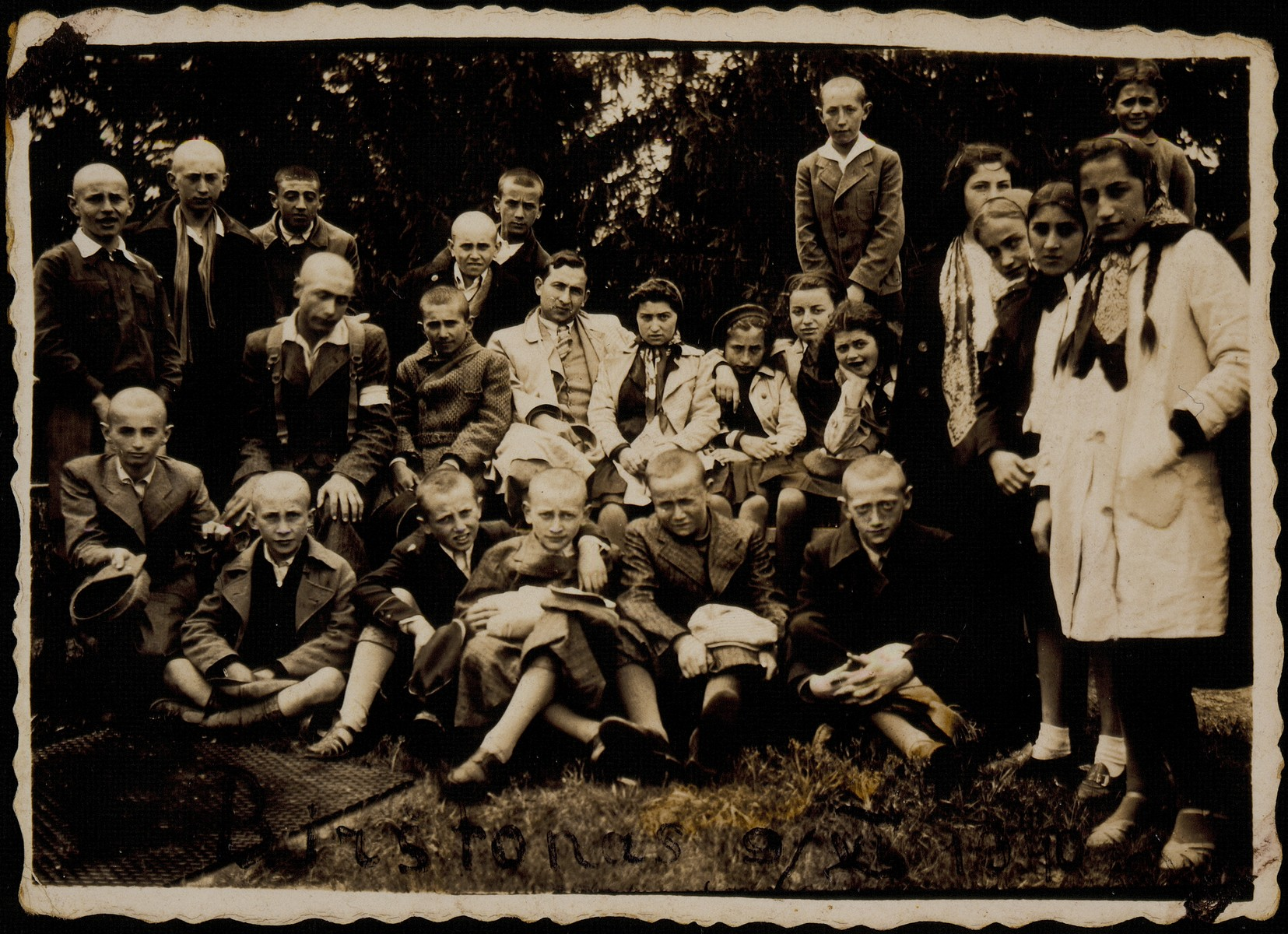 Hebrew School students visit historical sites in Lithuania in 1940.    The teacher Gabi is seated in the center. Sitting on the ground (right to left): Moshe Bastunski, Moshe Kaplan. To the left (sitting on his knees) is Elisha Koppelman. All the students and teachers perished during the Holocaust.