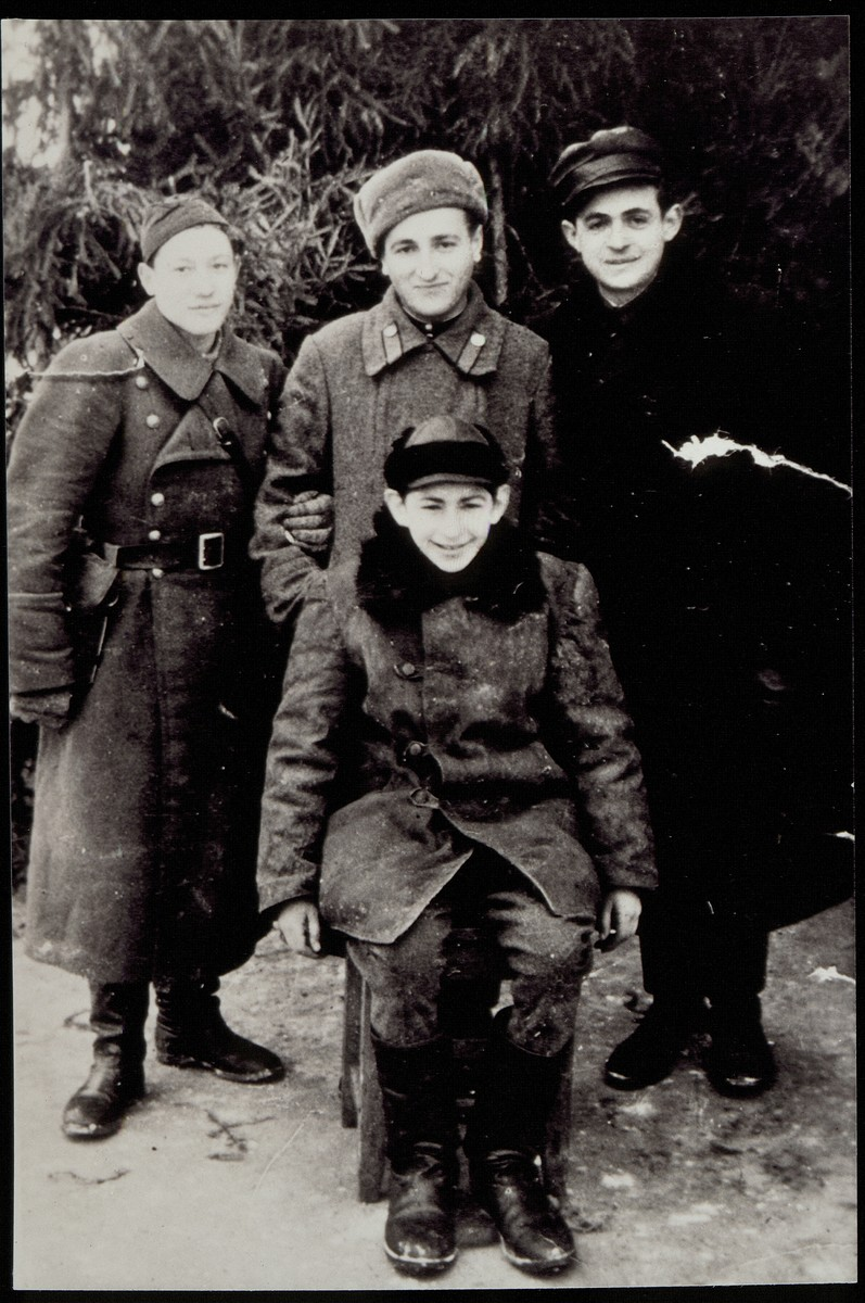 Yitzhak Sonenson (front) with three other Jewish partisans with whom he lived in fall 1944.   (right to left) Leibke Kaganowicz, Niomke Rogowski, and Hayyim Berkowitch (known as Pietka)