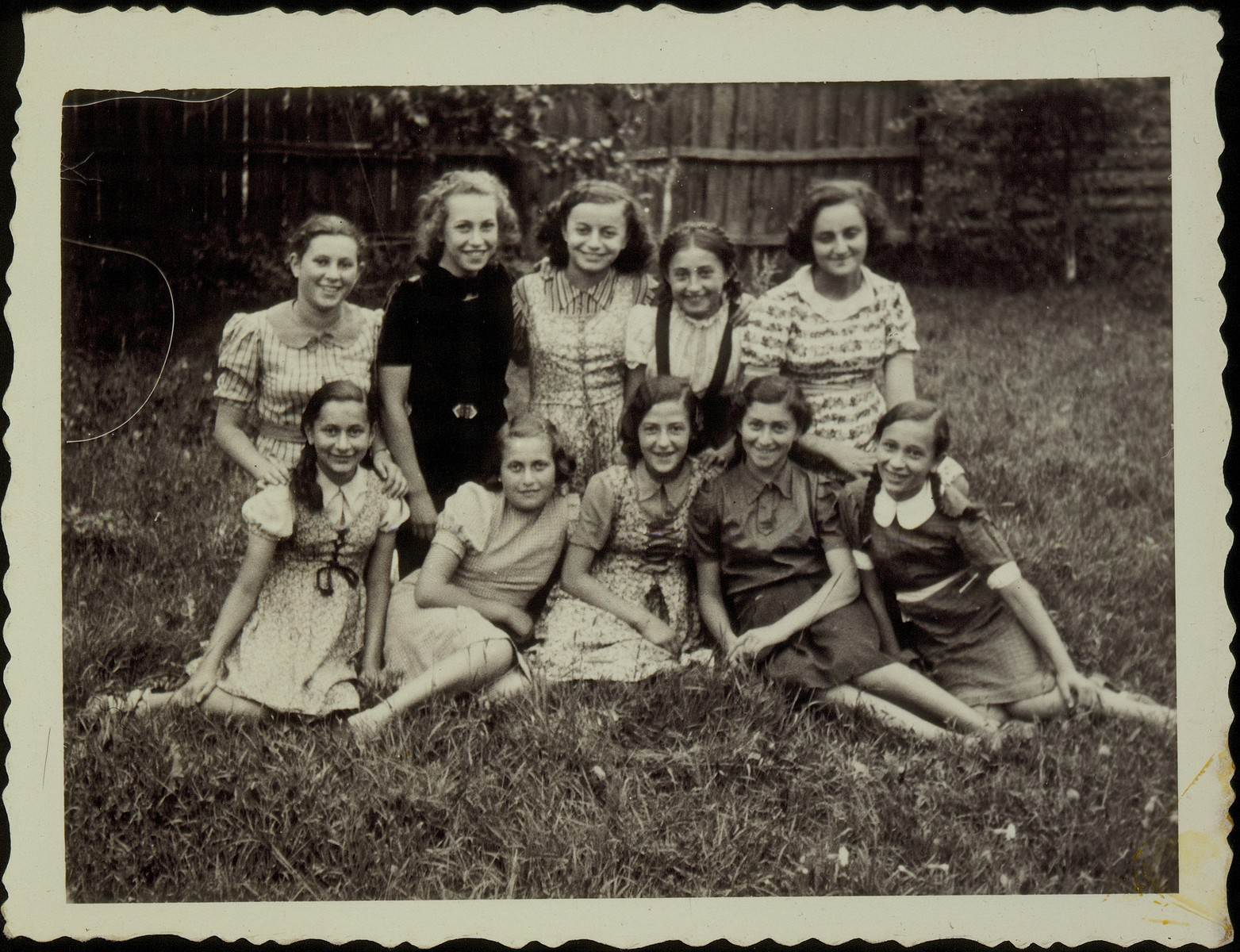 A group of young girls pose in a yard in the town of Eisiskes.  The Jews of this shtetl  were murdered by the Einsatzgruppen on September 21, 1941.