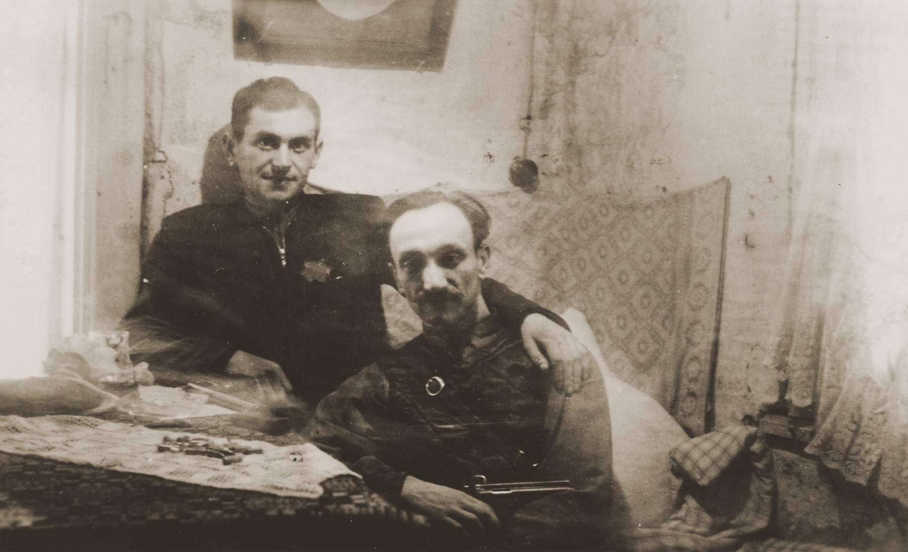 Two members of the Jewish General Fighting Organization in the Kovno ghetto.  Pictured are Chaim Yellin, leader of the ghetto underground and his assistant Moshe Musel.  Musel was one of Yellin's inner circle.  He worked in a garage and was responsible for arranging transportation for departing partisans.