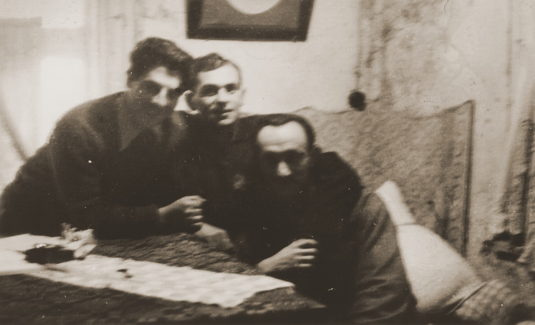 Three members of the Jewish General Fighting Organization in the Kovno ghetto.  Pictured are Chaim Yellin, leader of the Kovno ghetto underground, and two of his deputies, Moshe Musel and David Ratner.  Ratner, a professional photographer before the war, took pictures in the ghetto for the underground.
