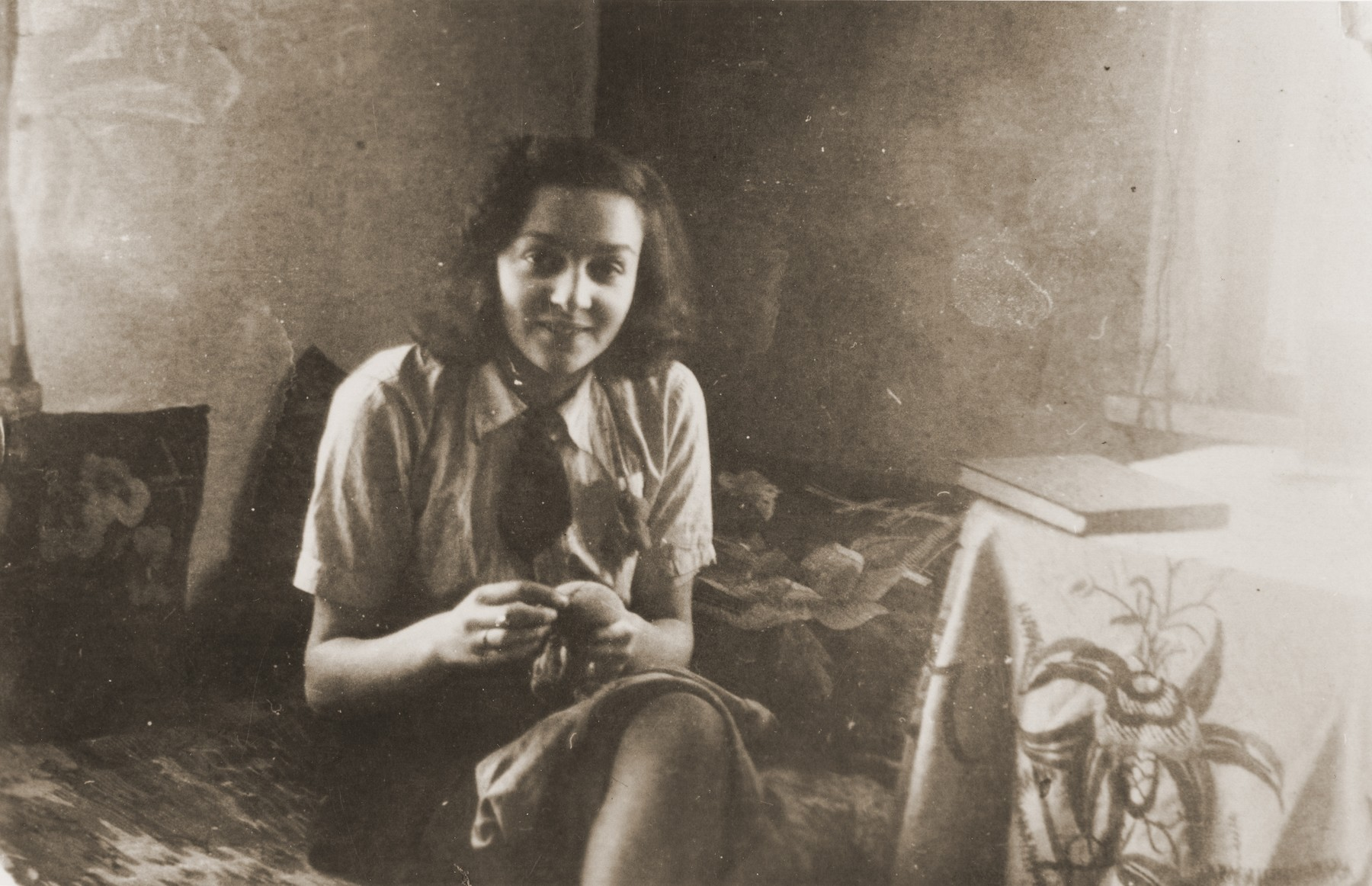 Portrait of Ida Karnovski sitting in her room in the Kovno ghetto.