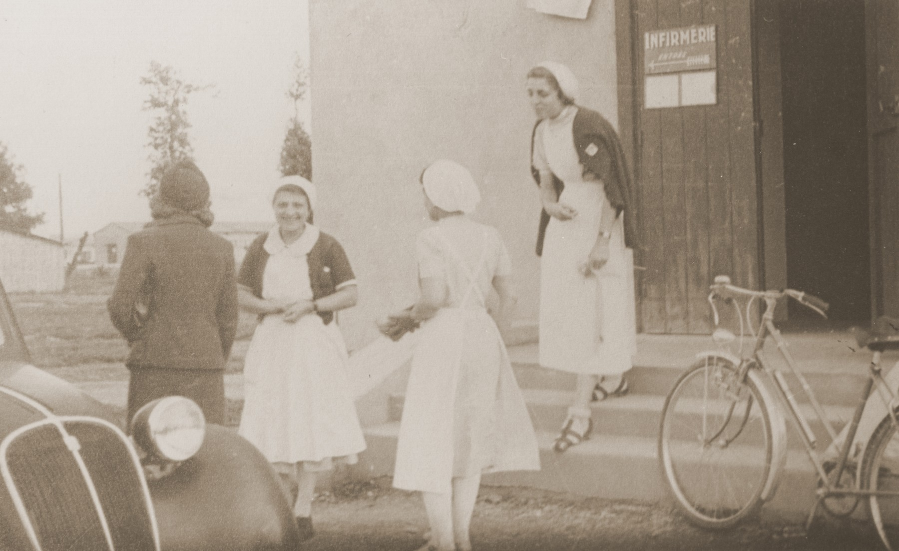 Nurses at the Recebedou camp infirmary. Second from the left is Isabelle Peloux, the aunt of Marie Genevieve Parmentier.  Marie Genevieve Parmentier was a ten year-old French girl living in Paris at the time of the German occupation in 1940. Her widowed mother sent her to safety with an old relative in Ariège in the South of France. She sooned joined her aunt, Isabelle Peloux, a military nurse, at the camp of Recebedou. While there she attended primary school at nearby Portet-sur-Garonne, before returning to her family in the summer of 1941.