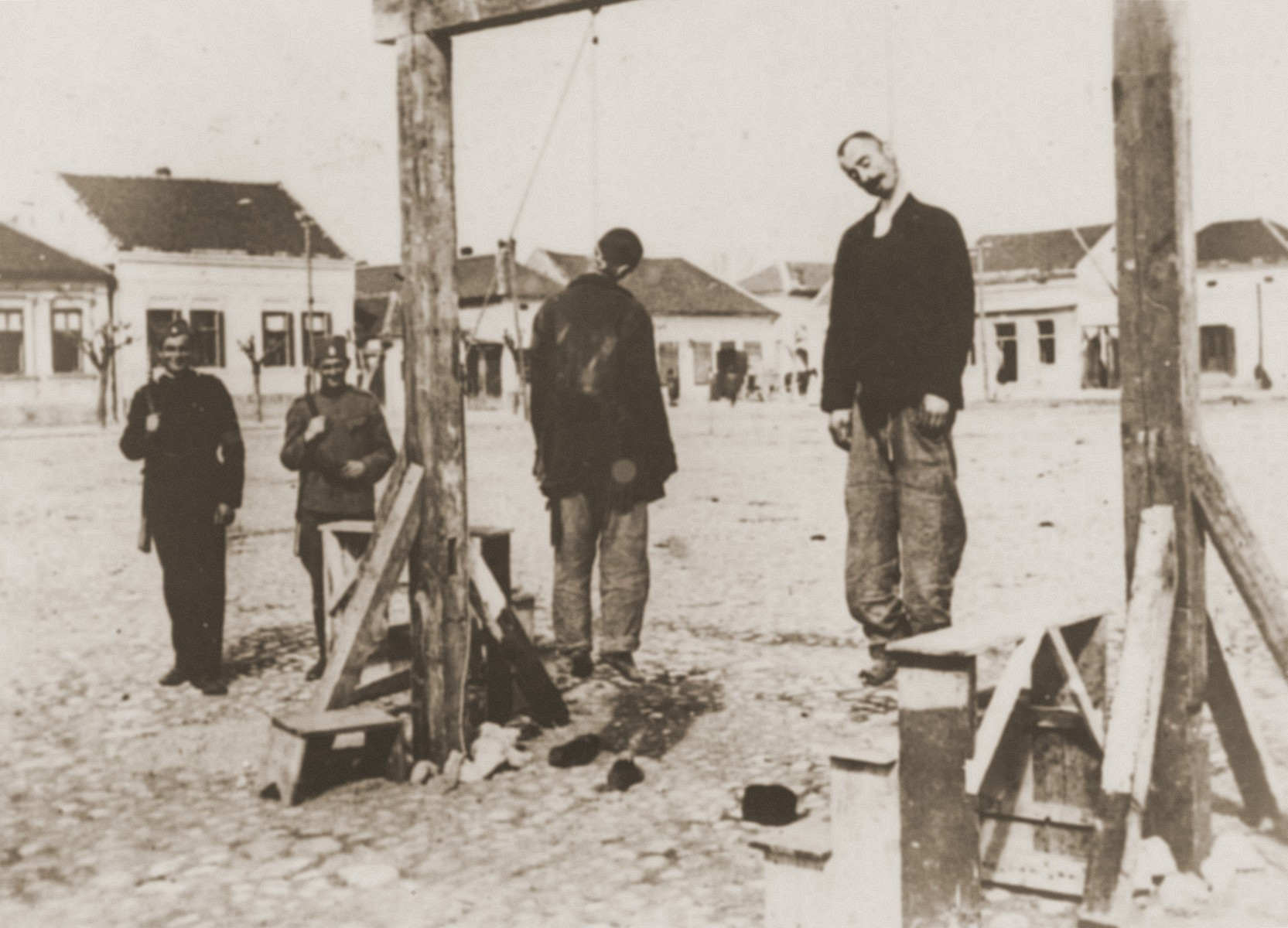 The bodies of Steven Borota and Yossipe Mayer, two Serbian partisans, hang from a gallows in Valjevo, where they were executed by Croatian collaborators under the command of Milan Neditch.