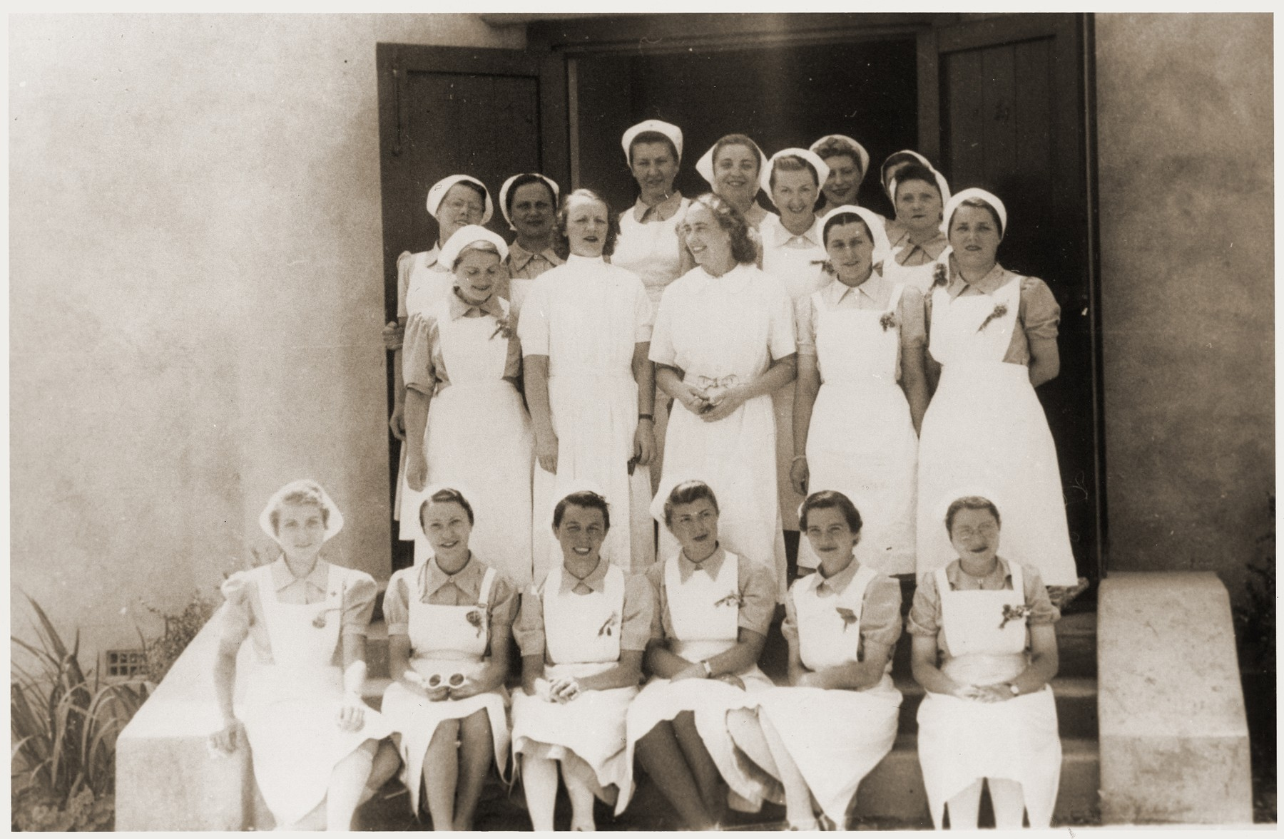 Nurses at the Recebedou camp infirmary.   Standing first from the left is Isabelle Peloux (aunt of Marie Genevieve Parmentier), Mademoiselle Baguelin, and Dr. Mirc. Behind Isabelle is Odette Clauzolles. Seated, second from the right, is Mademoiselle Rondespierre.  Marie Genevieve Parmentier was a ten year-old French girl living in Paris at the time of the German occupation in 1940. Her widowed mother sent her to safety with an old relative in Ariège in the South of France. She sooned joined her aunt, Isabelle Peloux, a military nurse, at the camp of Recebedou. While there she attended primary school at nearby Portet-sur-Garonne, before returning to her family in the summer of 1941.