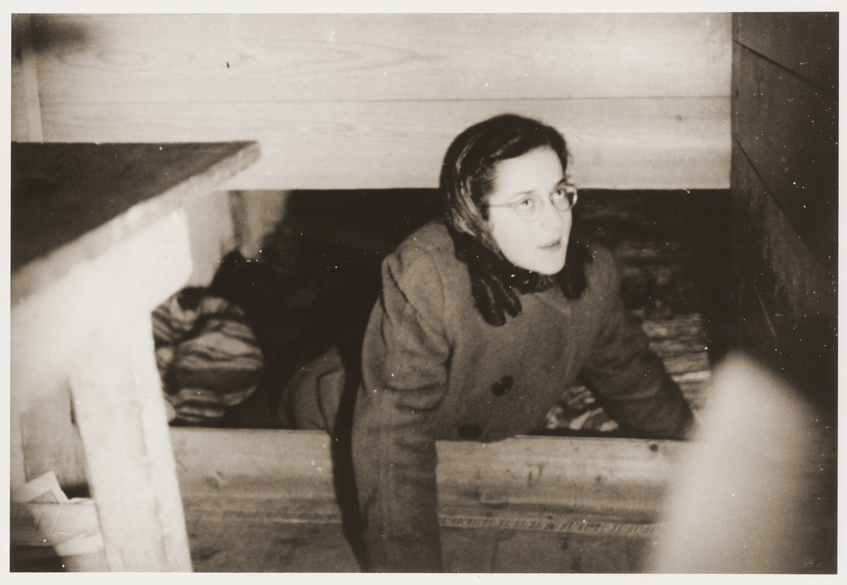 Suse Grunbaum lies in an attic storeroom at the home of Bernard and Mina Hartemink in Sinderen, the Netherlands, where she was hidden during the war.