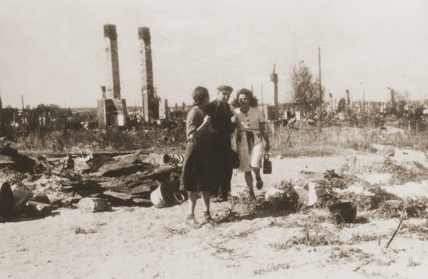 Survivors of the Kovno ghetto view the ruins of the ghetto after liberation.
