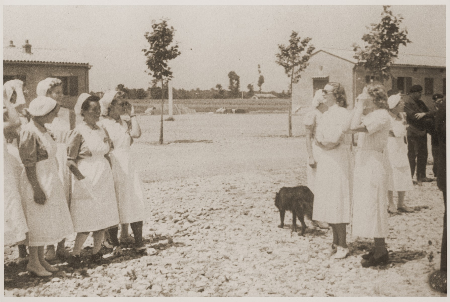 Some nurses gather outside on the grounds of the Recebedou camp.