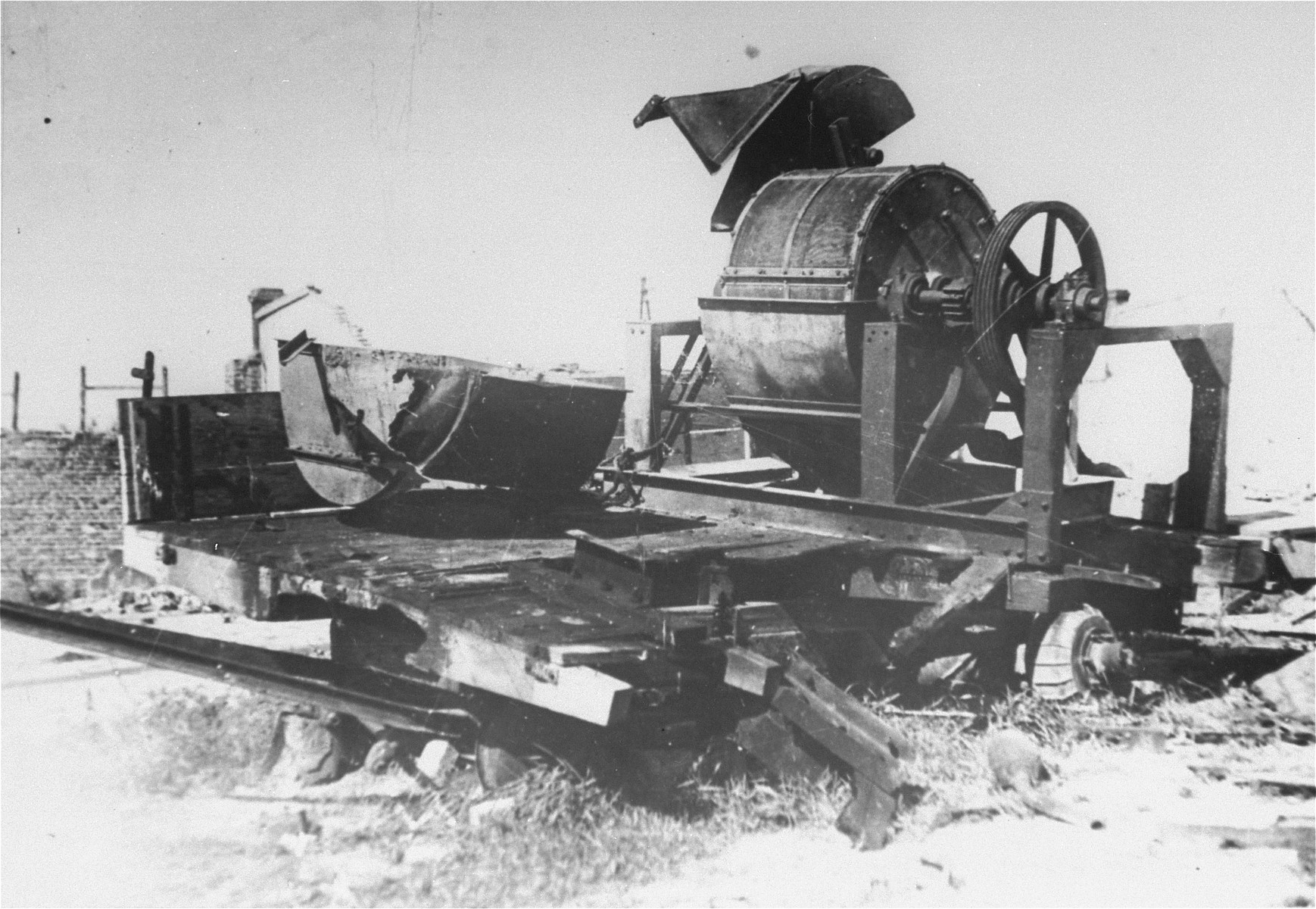 "View of the bone crushing machine used by Sonderkommando 1005 in the Janowska concentration camp to grind the bones of victims after their bodies were burned.    The photo was taken by members of a Soviet war crimes commission soon after the liberation.  Original caption reads, ""To illustrate the communique of the Extraordinary State Committee on the crimes committed by the Germans on the territory of the Lvov region.  In the camps of the Lvov Region the Germans exterminated hundreds of thousands of Soviet citizens, war-prisoners and nationals of foreign states.  A German machine for crushing the bones of their burned victims."""