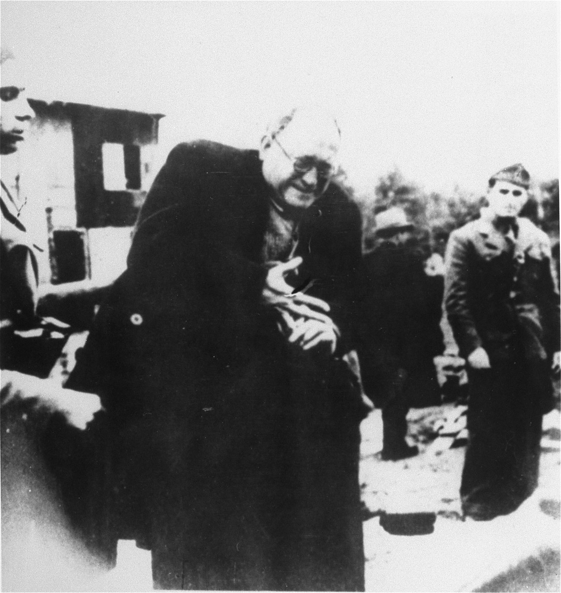 A Jewish prisoner is forced to remove his ring upon his arrival in the Jasenovac concentration camp.  Pictured is Teodore Grunfeld.