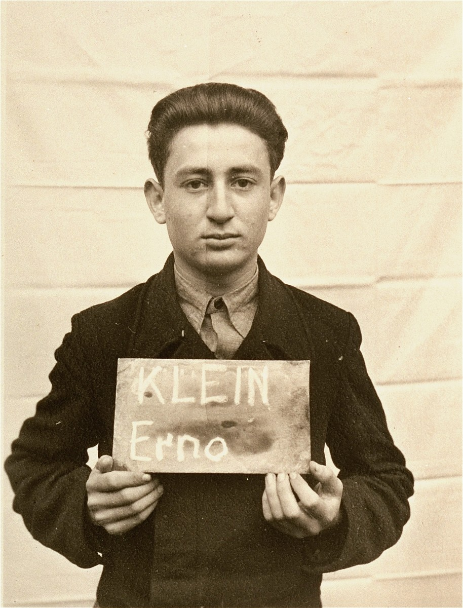 Erno Klein holds a name card intended to help any of his surviving family members locate him at the Kloster Indersdorf DP camp.  This photograph was published in newspapers to facilitate reuniting the family.