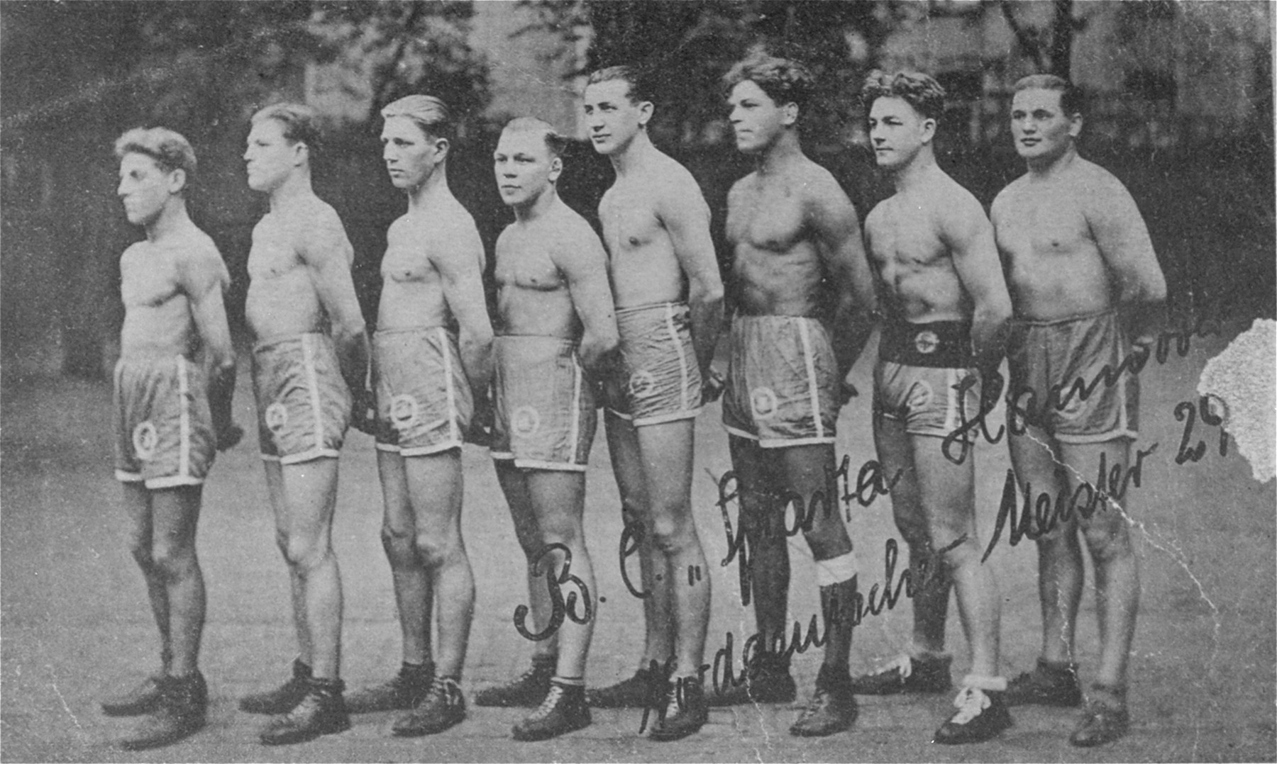 "Group portrait of the members of the German boxing club, Sparta, after winning the North German championship.  The Sinti boxing champion, Johann (Rukelie) Trollmann (1906-1943), is pictured third from the right.  In 1932 Johann Trollmann, a Gypsy from Hannover, was considered one of the most successful boxers in Germany.  His future looked promising until the Nazi seizure of power and the subsequent aryanization of the German boxing league.  On June 9, 1933, Trollmann fought a bout to determine the new middle-weight championship.  (The title had been taken away from the Jewish boxer Erich Seelig in March.)  Though the judges gave the victory to Trollmann, officials of the boxing league intervened to declare it a draw.  Only after strong protests from the audience did the officials back down and award him the championship.  However, soon after the fight the boxing league withdrew the title.  In order to continue boxing Trollmann was forced to abandon his particular boxing style, which sports journalists had begun to ridicule in their magazines.  As a result, he was knocked out in an important bout of July 21, 1933.  Subsequently, he fought and lost several other matches, apparently due to pressure from the boxing league.  In 1939 Trollmann was drafted into the German army, where he fought with the infantry on the eastern front.  In 1942 he was arrested while at the home of his brother.  He was taken to a police station and severely beaten.  From there Trollmann was deported to the Neuengamme concentration camp, where he was forced to perform hard labor.  SS camp personnel often brought the starving Trollmann to their gatherings, plied him with drink, and then forced him to box with them.  He was shot on February 9, 1943.  [Krausnick, Michail, ""Wo sind sie hingekommen?""  Bleicher Verlag, Gerlingen, 1945]"