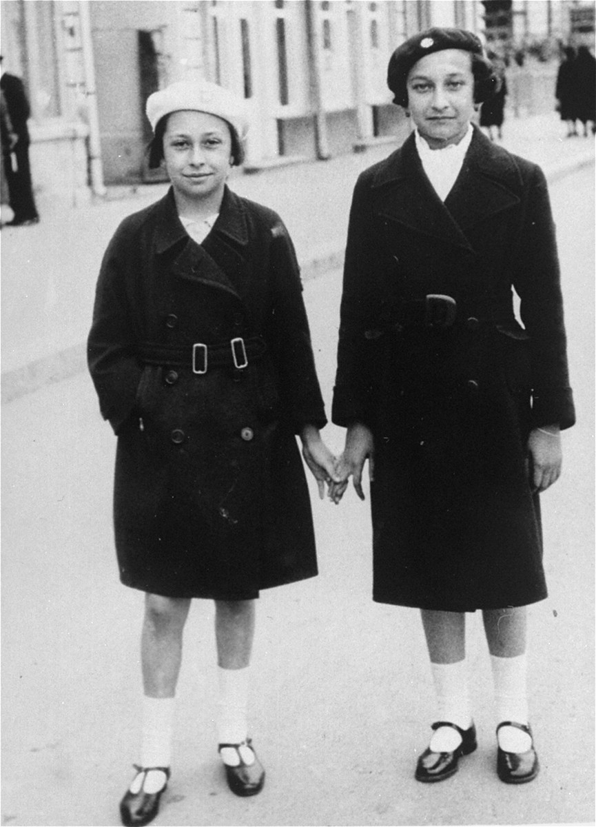 Two Jewish cousins pose on a street in Bacau, Romania.   Pictured are Jeanine Gutman (right) with her cousin Anna Erlich (left).