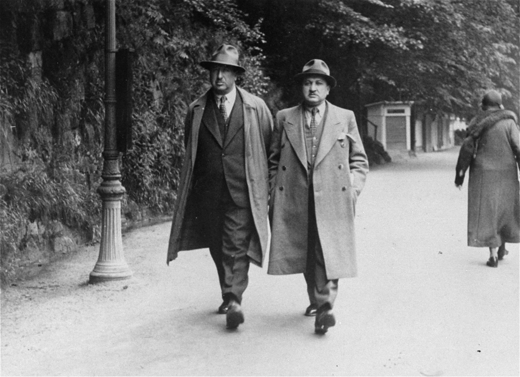 Two Jewish men from Romania stroll along a street in the Karlsbad spa.  Pictured are Leon Gutman, Jeanine Gutman's father, with his brother-in-law.