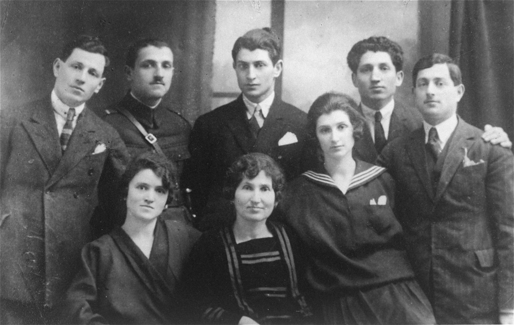 Prewar portrait of a Romanian Jewish family.  Pictured are the Weisz family.  From left to right: (back row) Hermann, Joseph, Moshe, Marcel, and Alexander (front row) Rose, Lenke Friedman-Weisz, and Olga. Hermann later married Magda Pollak and had a child, Evi.