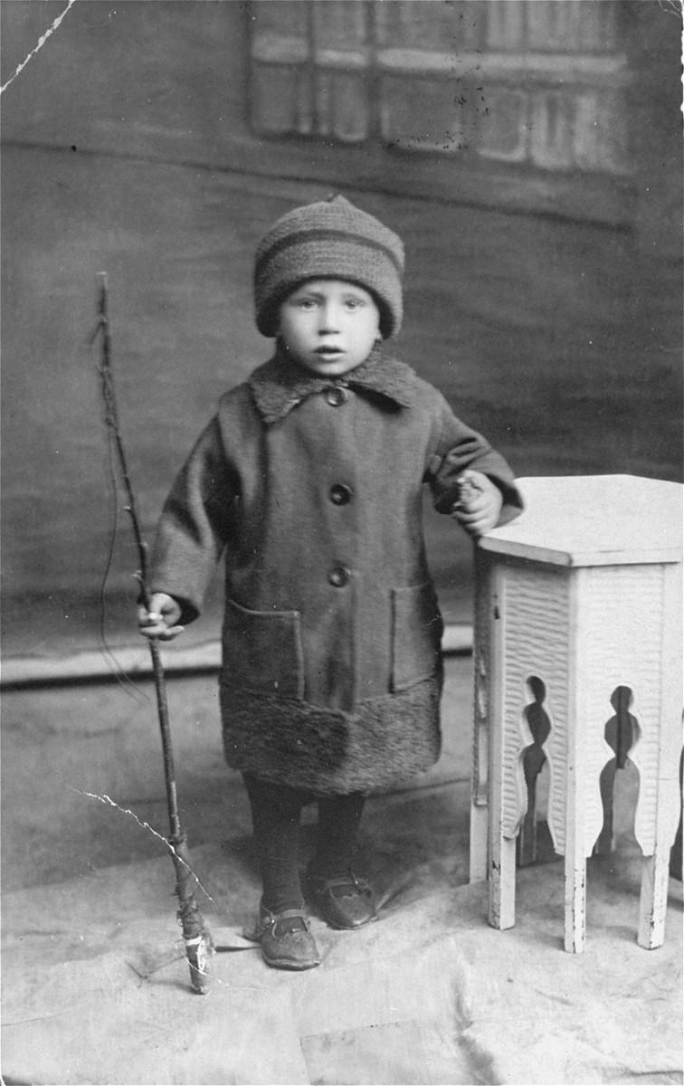 Studio portrait of a Jewish child, Ion Butnaru, in Husi, Romania.