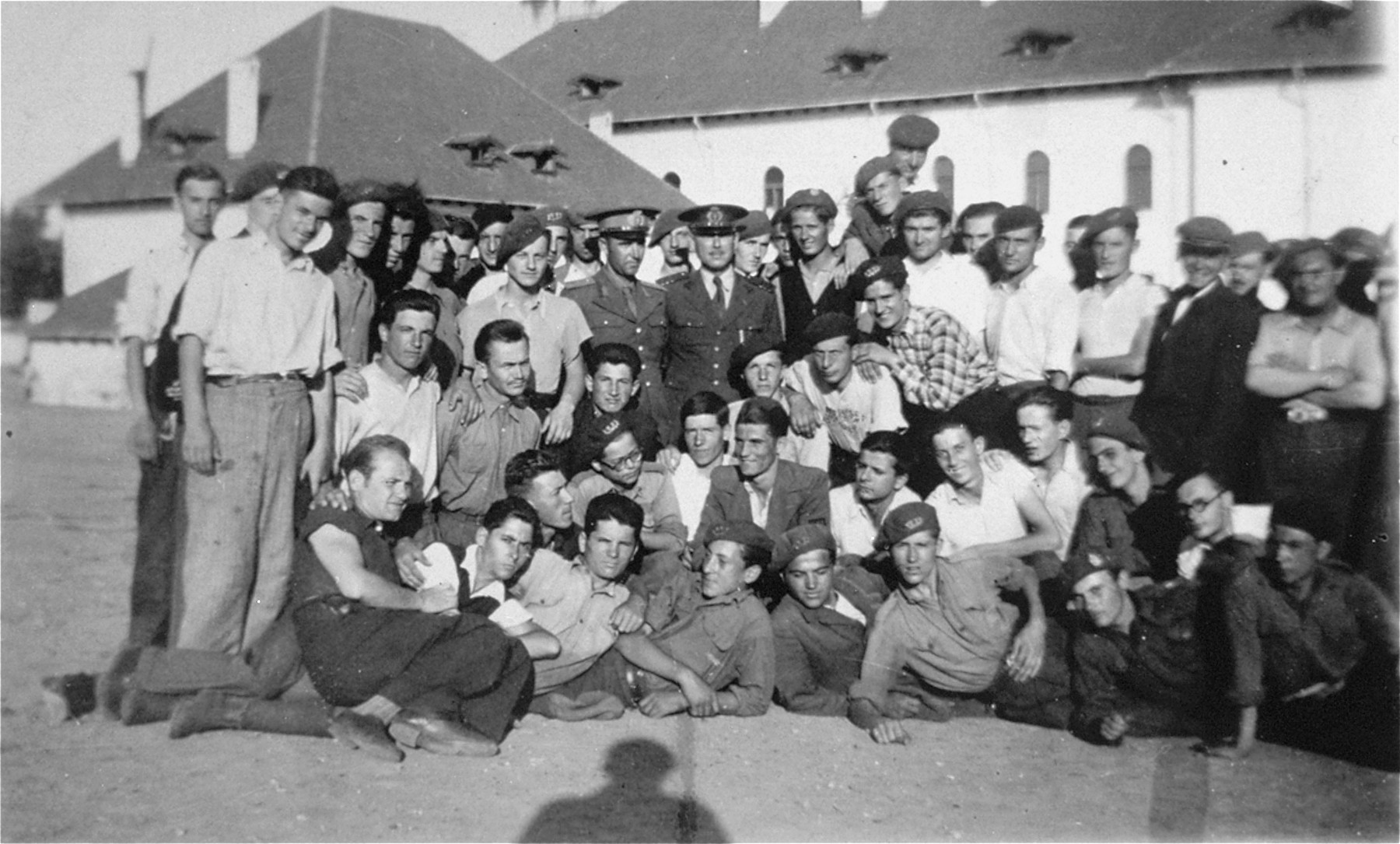 Group portrait of Jewish and Romanian students in a public high school in Husi, Romania.  Among those pictured is Ion Butnaru.