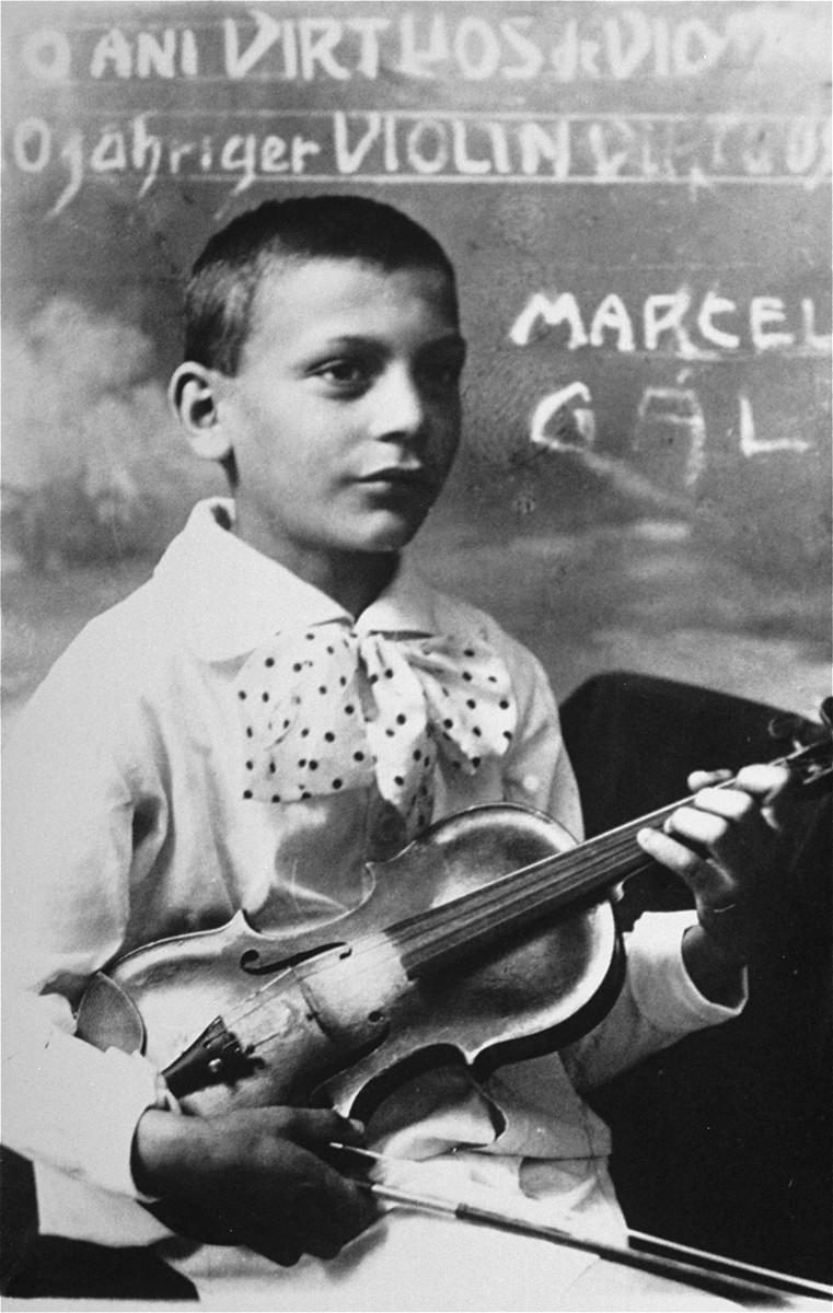 "Portrait of Marcell (nicknamed ""Bandi"")  Gal (born Gottlieb), a child violin prodigy from Sighet.  His brother, Janos, was also a violinist.    One photograph among a series of family portraits taken by a Jewish studio photographer in Sighet, Romania in the 1920's and 30's."